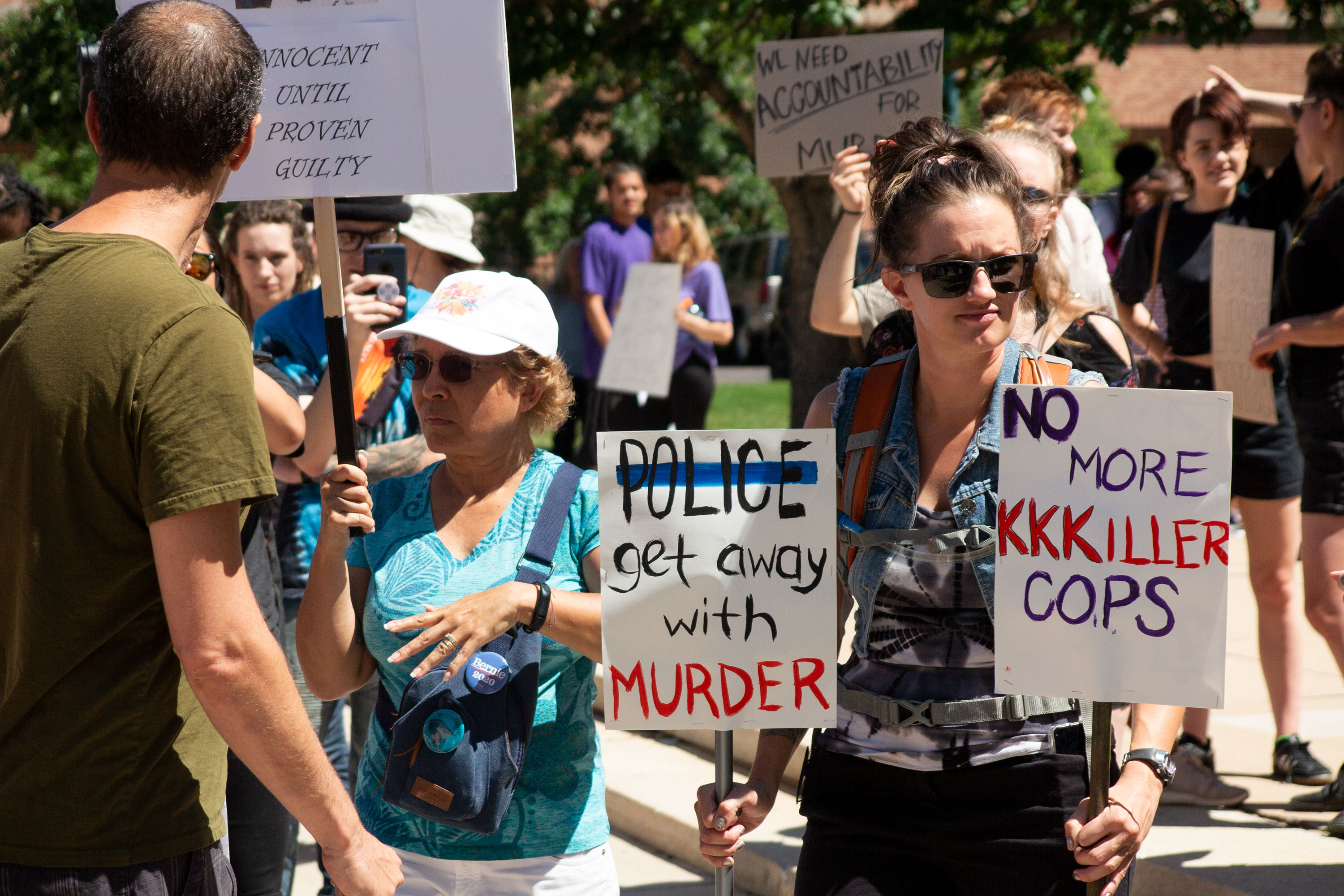 Demonstrators protest a fatal officer-involved shooting that occurred over the weekend in Colorado Springs on Monday, Aug. 5, 2019.