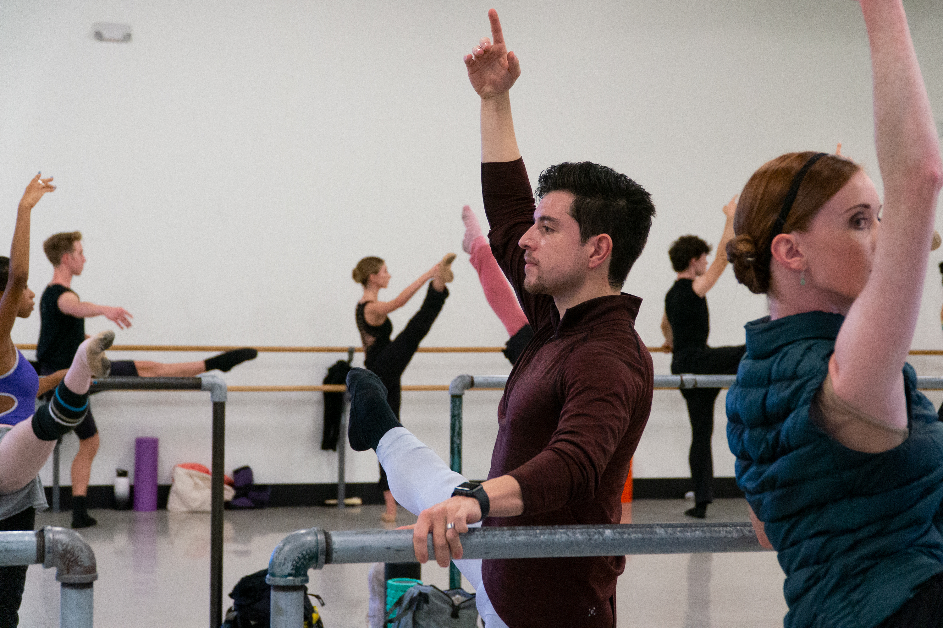 Colorado Ballet principal dancer Francisco Estevez warms up his muscles at the ballet barre during the company's morning technique class on Sept. 24, 2019.