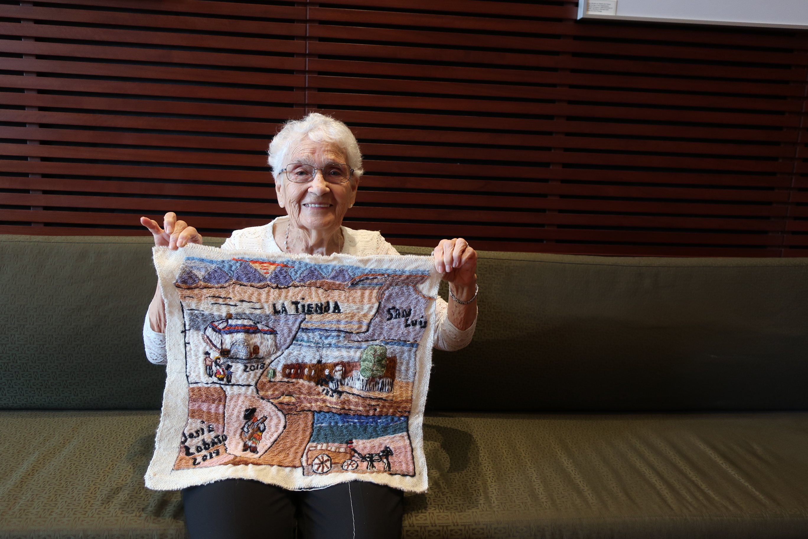 Colcha artist Josephine Lobato displays one of her works that led to an NEA National Heritage fellowship.