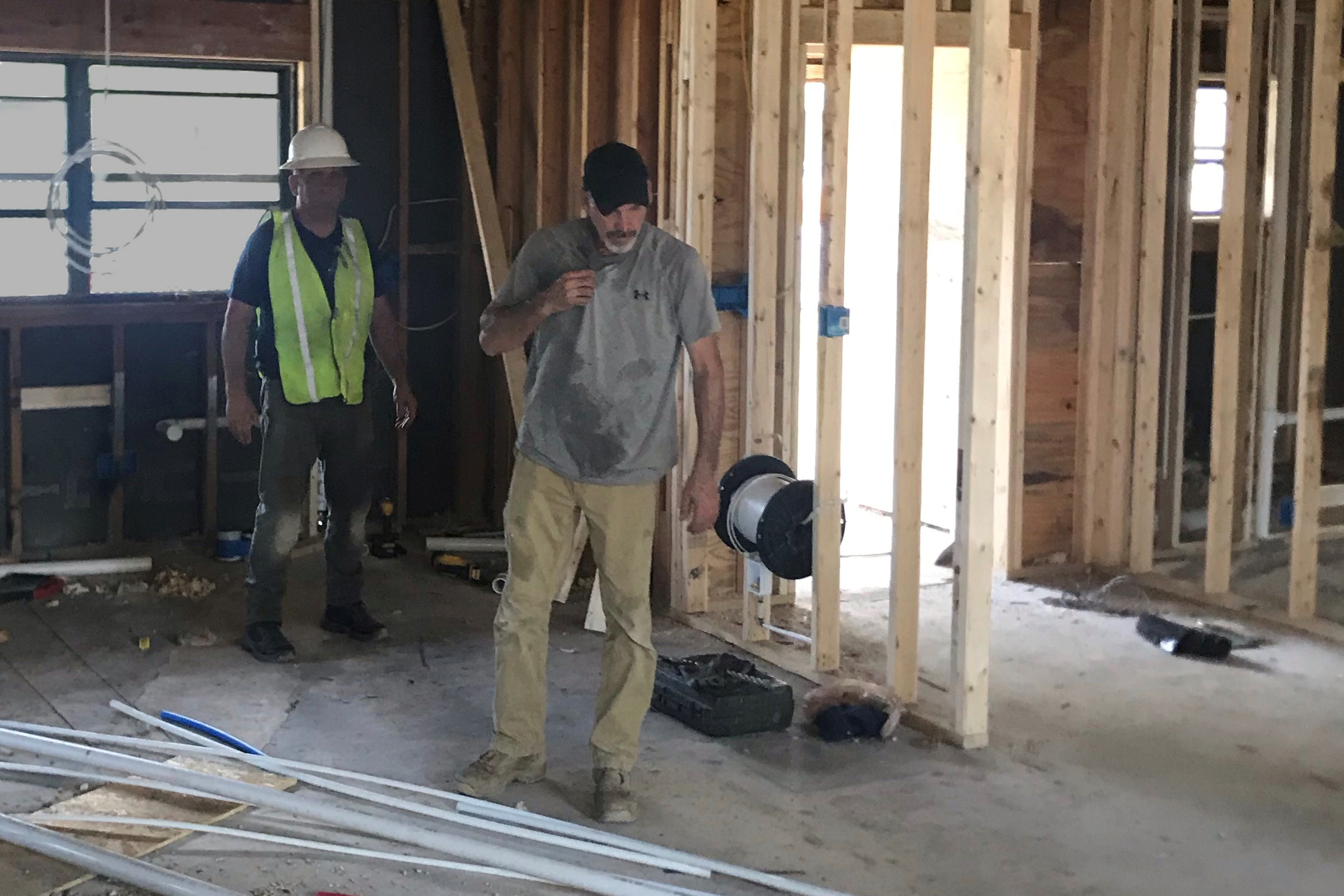 Contruction crews renovate the kitchen and dining room of a home on Fort Bragg, N.C.