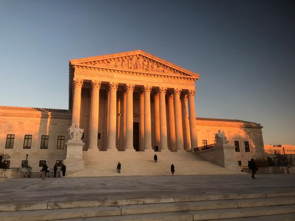 The U.S. Supreme Court building at sunset.