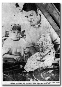 A young Don Sanborn and his Uncle Nick look at a roast and potatoes in foil, ready to wrap them up and cook them on the manifold of their race car. Sanborn says the meal was a project for the cooking section of the Gazette.
