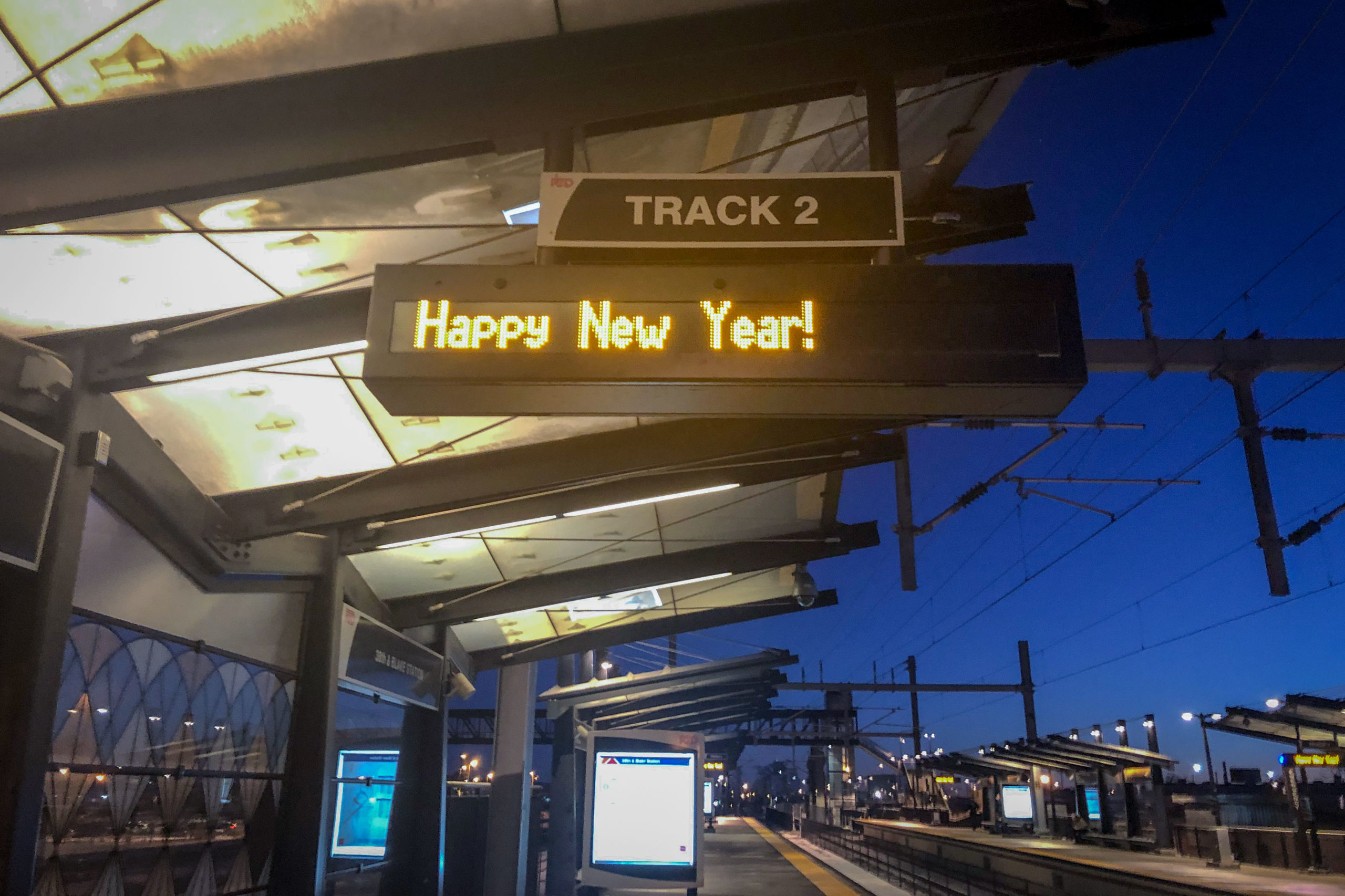 "A ""Happy New Year"" message displayed on the status boards at the RTD station at 38th and Blake, Denver, Dec. 31, 2019."