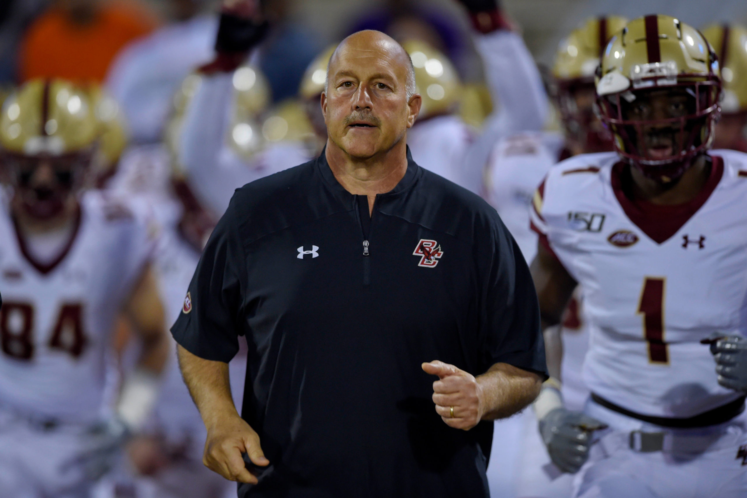 In this Oct. 26, 2019 file photo Boston College head coach Steve Addazio leads his team onto the field before the start of an NCAA college football game against Clemson in Clemson, S.C.