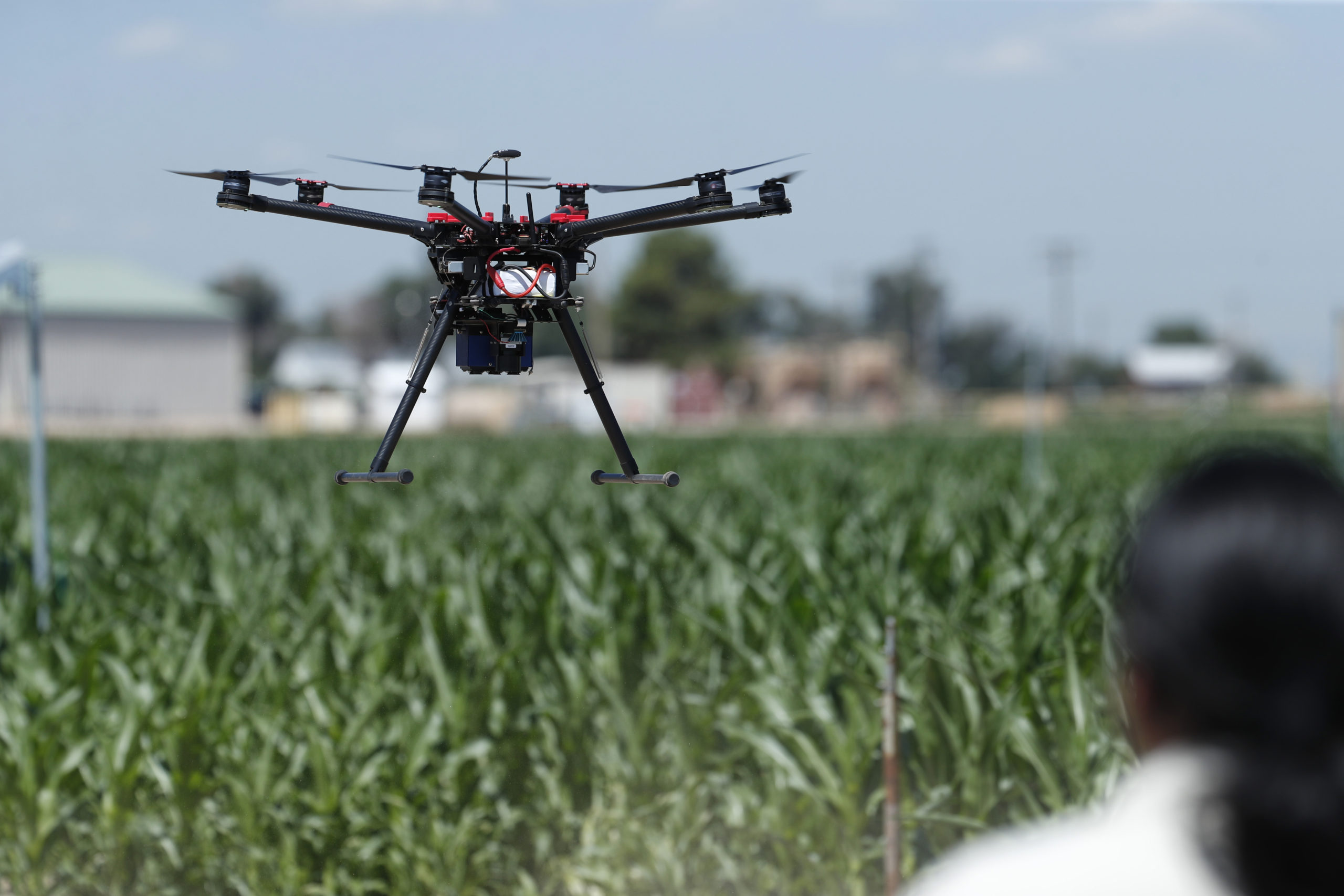 United States Department of Agriculture engineering technician Kevin Yemoto guides a drone into the air at a research farm northeast of Greeley, Colo., July 11, 2019.