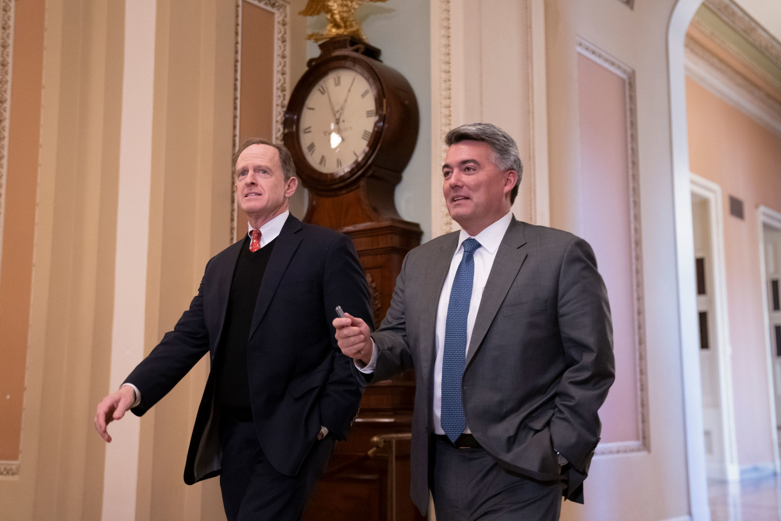 Sen. Pat Toomey, R-Pa., left, and Sen. Cory Gardner, R-Colo., arrives at the Senate for the start of the impeachment trial of President Donald Trump on charges of abuse of power and obstruction of Congress, at the Capitol in Washington, Tuesday, Jan. 21, 2020.