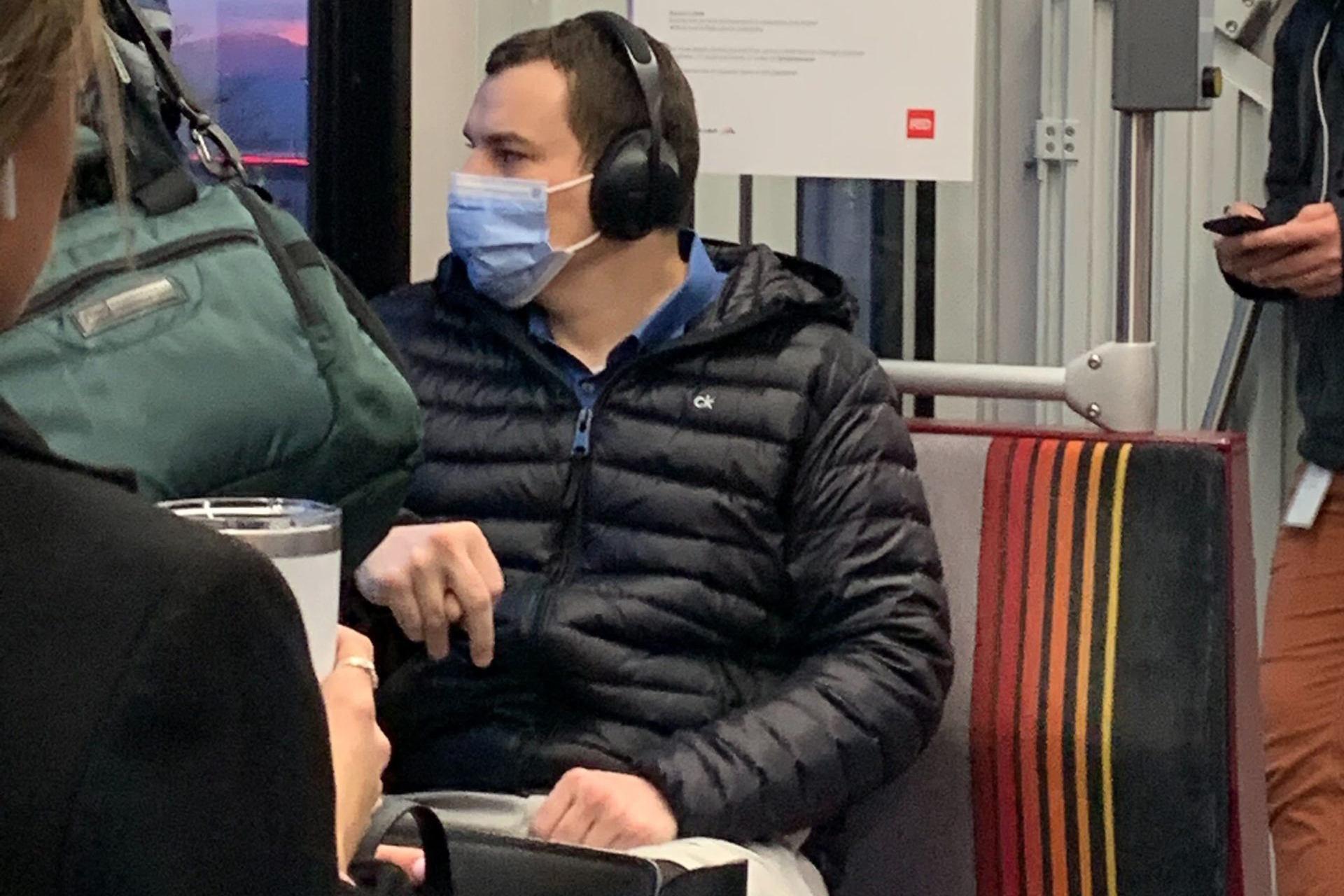 A man wears a health mask while riding RTD's light rail on January 27, 2020.