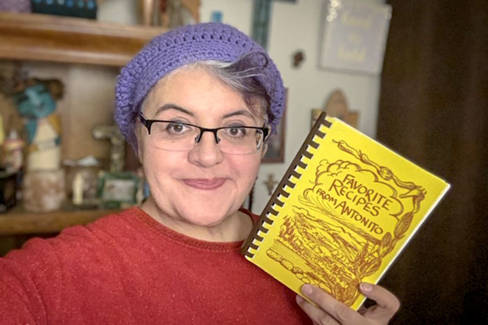 "A selfie from Roz Gallegos with her ""Favorite Recipes from Antonito"" cookbook."