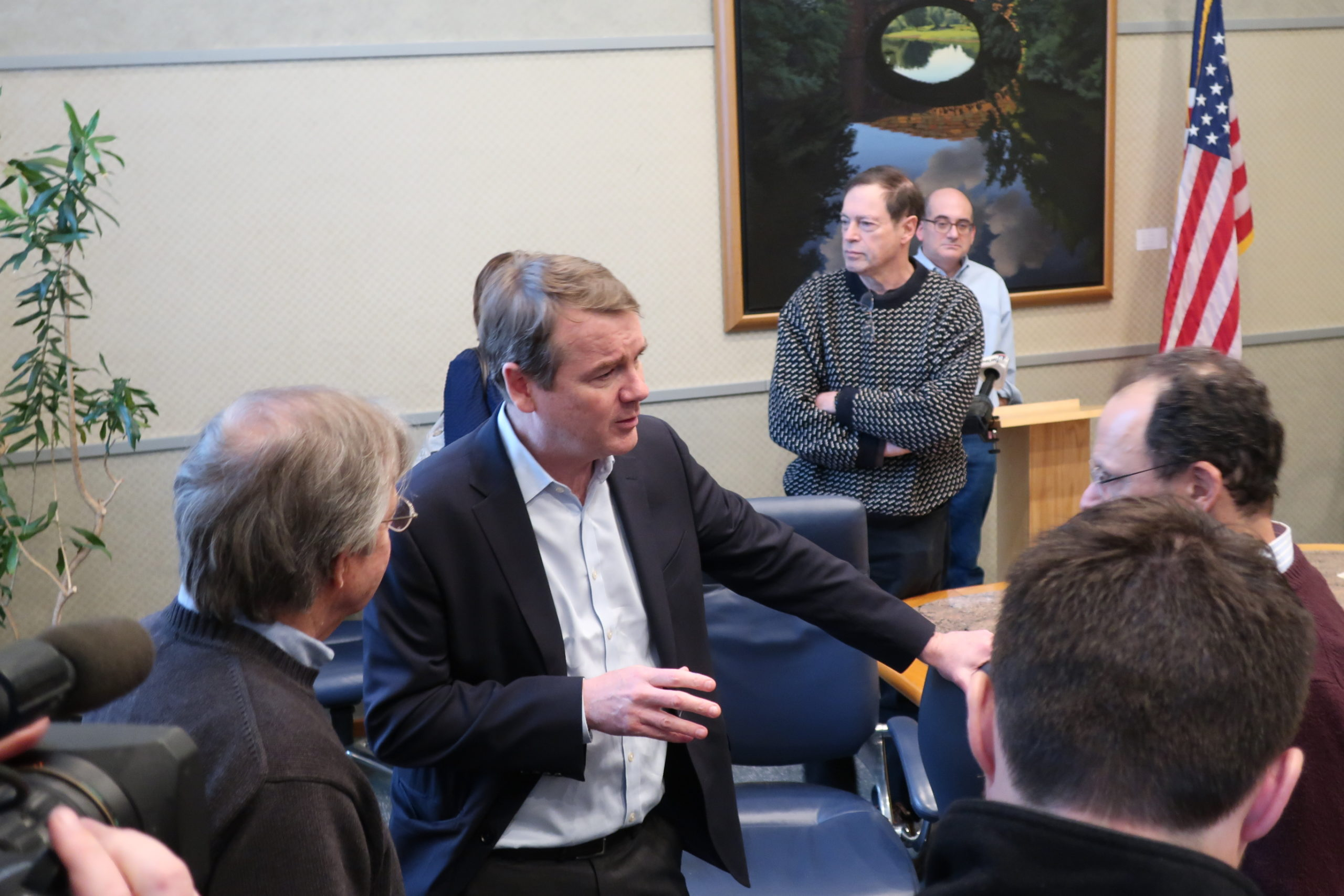 Michael Bennet talking to voters after a meet and greet event in Manchester on February 7, 2020.