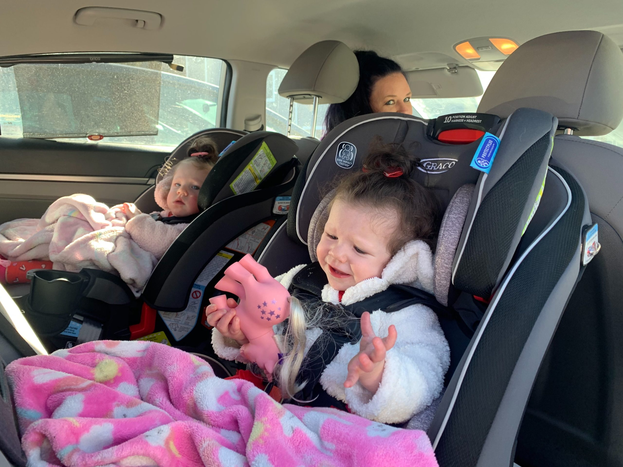 Kairi (left) and Blake, 1, with their mother, Jenna Riley, before they drive to lunch on Feb. 14, 2020.
