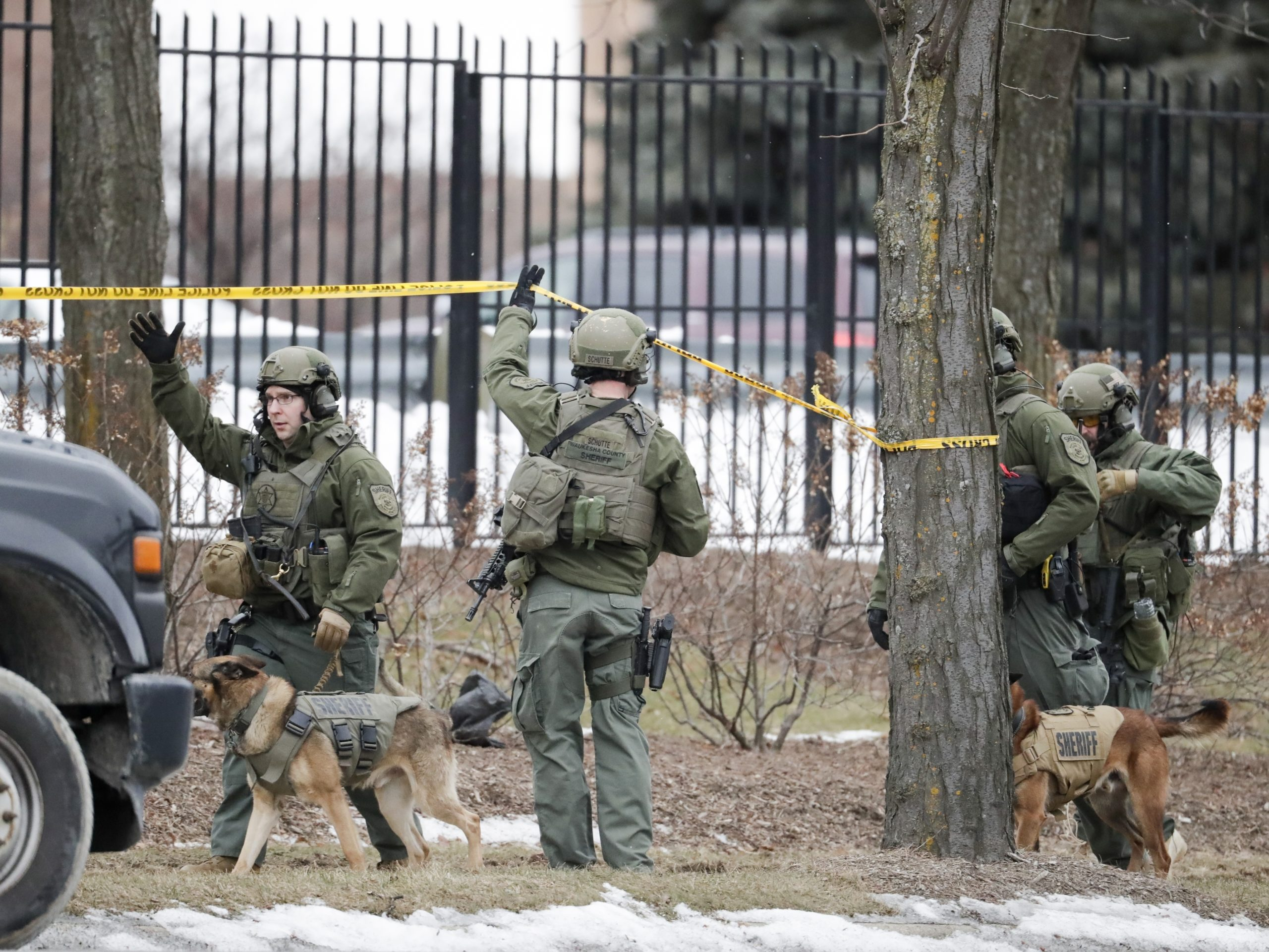 Police respond to reports of an active shooting at the Molson Coors Brewing Co. campus in Milwaukee, on Wednesday.