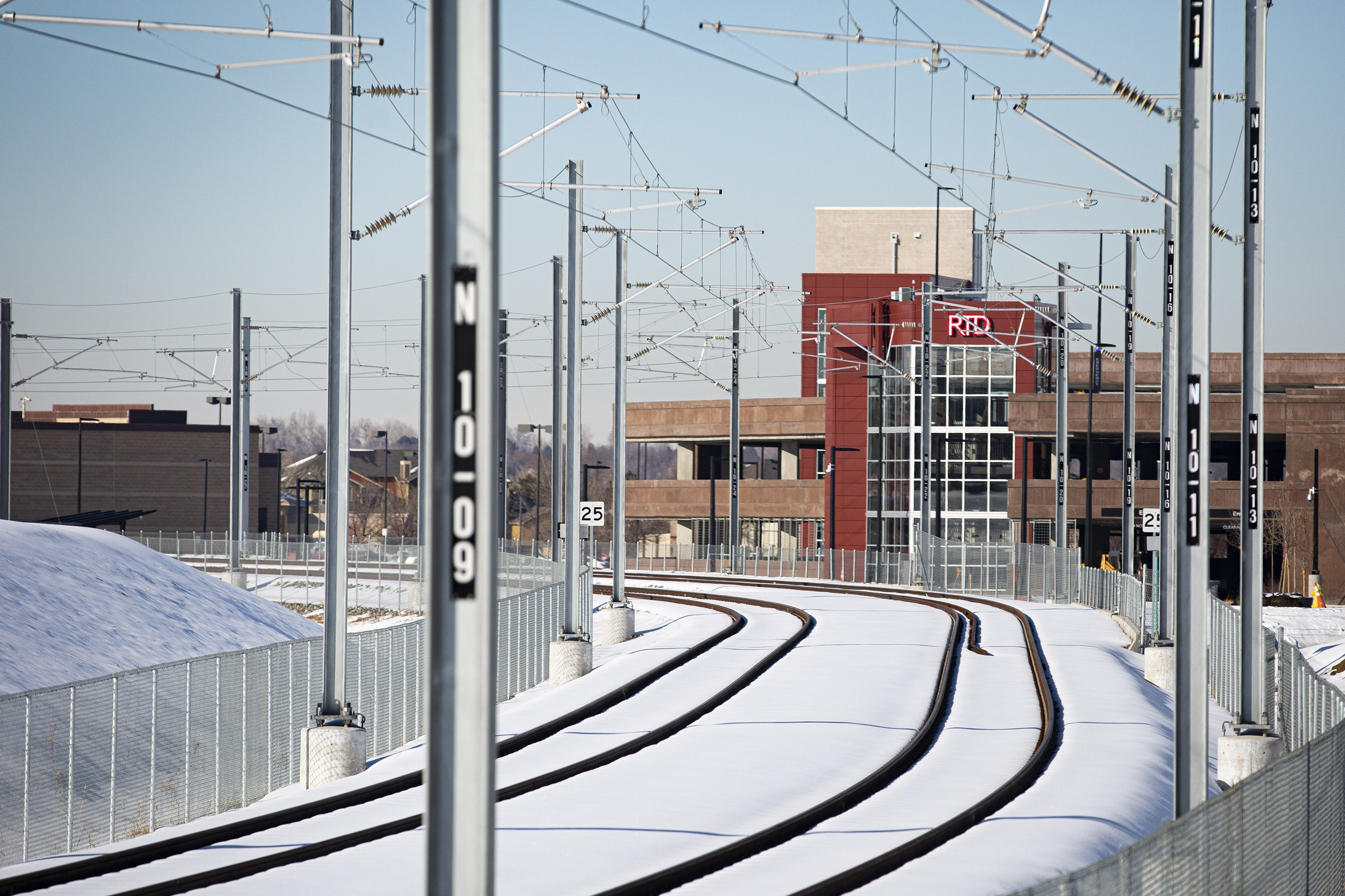 Tracks and a park and ride for RTD's N Line as seen from Colorado Boulevard in Thornton, Colorado in February 2020.