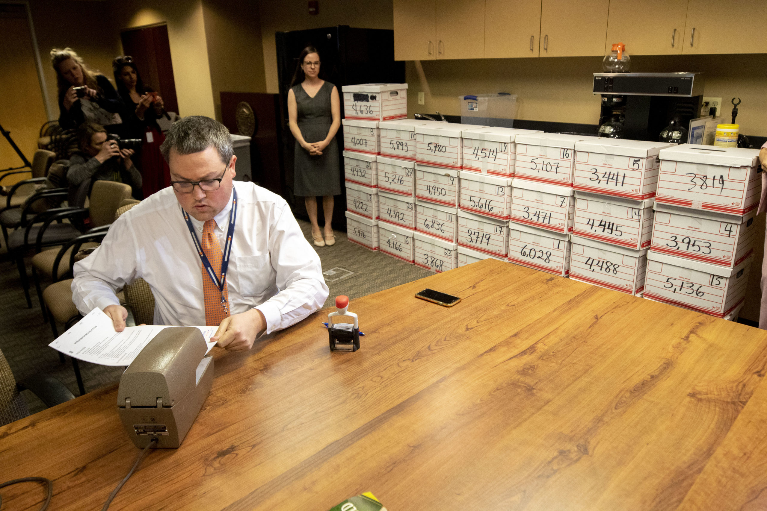 Jeff Mustin, petitions lead with the Colorado Secretary of State's office, timestamps a delivery of signatures for a 22-weeks abortion ban ballot measure. March 4, 2020.