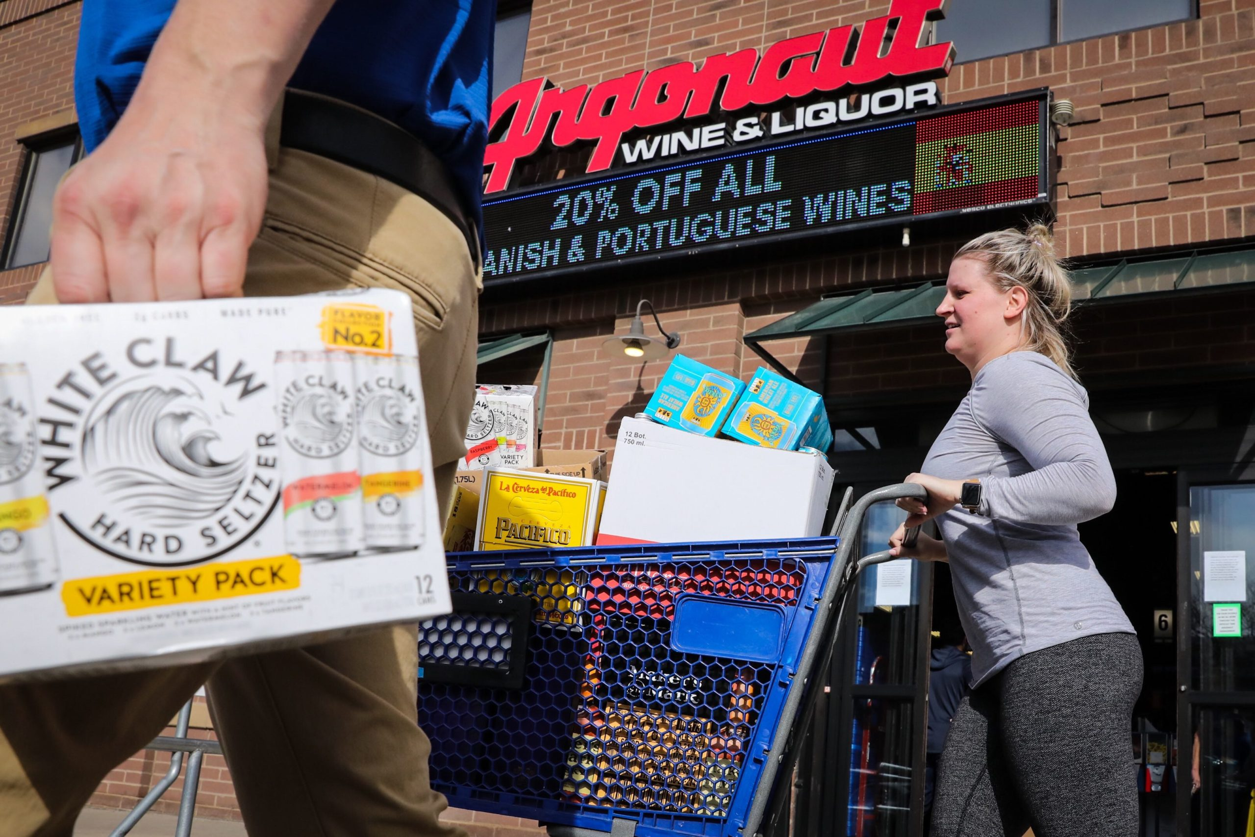 Customers lined up around Argonaut Liquors on Colfax Avenue and left with carts piled high on Monday, March 23 after Denver Mayor Michael Hancock ordered liquor stores and pot shops to be closed by 5 p.m. Tuesday to combat coronavirus.