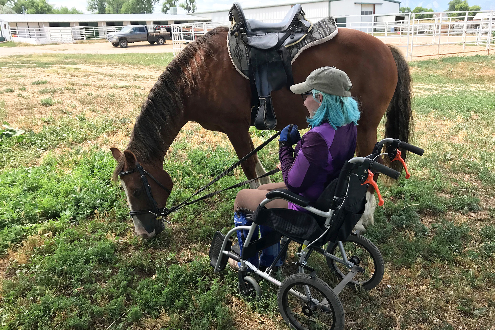 Andi Rudman with her horse, Rowan. Rudman is 29, lives in Boulder and has Klippel Feil Syndrome, a congenital defect that has resulted in severe chronic pain. Coronavirus has put her pain management health care on hold.