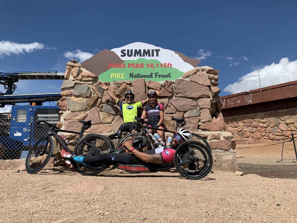 From top left: Mohamed Lahna, 2016 medalist in para-triathlon, Jamie Whitmore, 2016 medalist in para-cycling, and Brandon Lyons, member of the U.S. Paralympics Cycling 2020 National Team, at the summit of Pikes Peak.