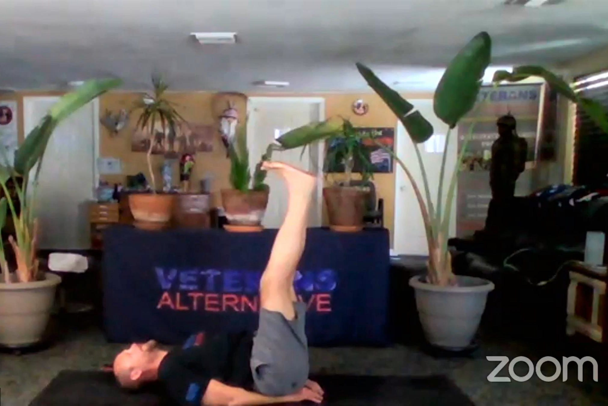 Yoga instructor Forest Spall with the Tampa-area nonprofit group Veterans Alternative hosts a virtual meditation session on the video chat service Zoom.