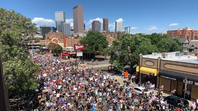 Thousands take part in a Black Lives Matter march along Colfax Avenue on Sunday, June 7, 2020, in Denver.