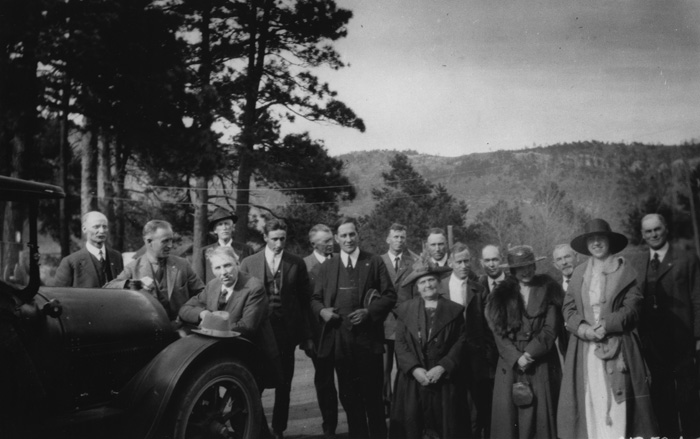Pueblo city, county, and forest officials with Arthur Carhart in center and his wife Vera Carhart fourth from right at Pueblo Municipal Camp area. Members of the Pueblo Commerce Club, with input from Arthur Carhart and forest supervisor Al Hamel, formed the non-profit San Isabel Public Recreation Association on November 6, 1919.