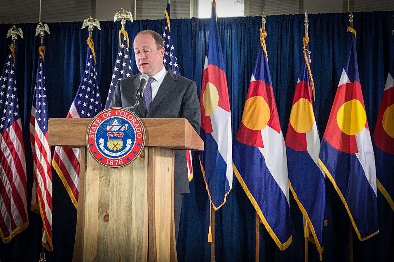 Gov. Jared Polis speaks at the carriage house of the governor's residence at Boettcher Mansion, June 4, 2020.
