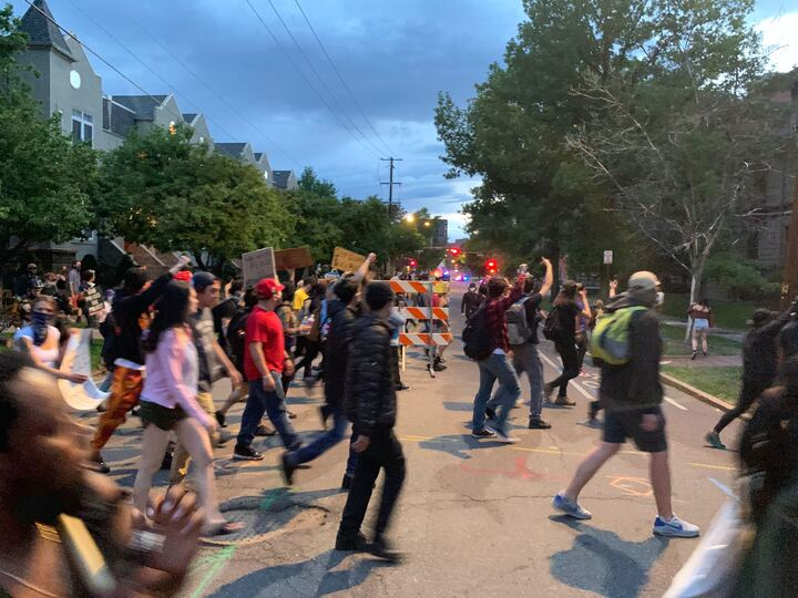 Protesters calling for police accountability in the wake of George Floyd's death march along Emerson Street on Sunday, May 31, near downtown Denver, after the city's 8 p.m. curfew went into effect.