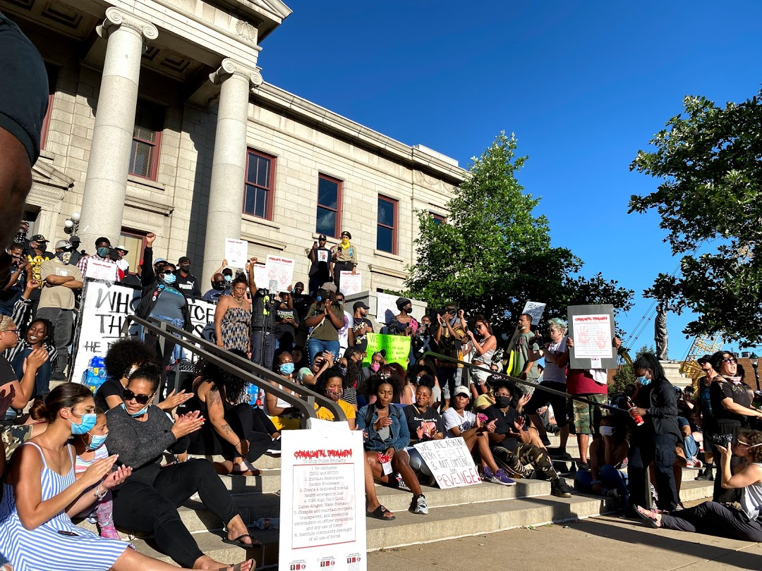Hundreds of protesters gathered on and around the steps to Colorado Springs' City Hall Sunday to call for an end to police brutality. It was the ninth day of protests in the city. Here, the speaker called all black women to join her on the steps.