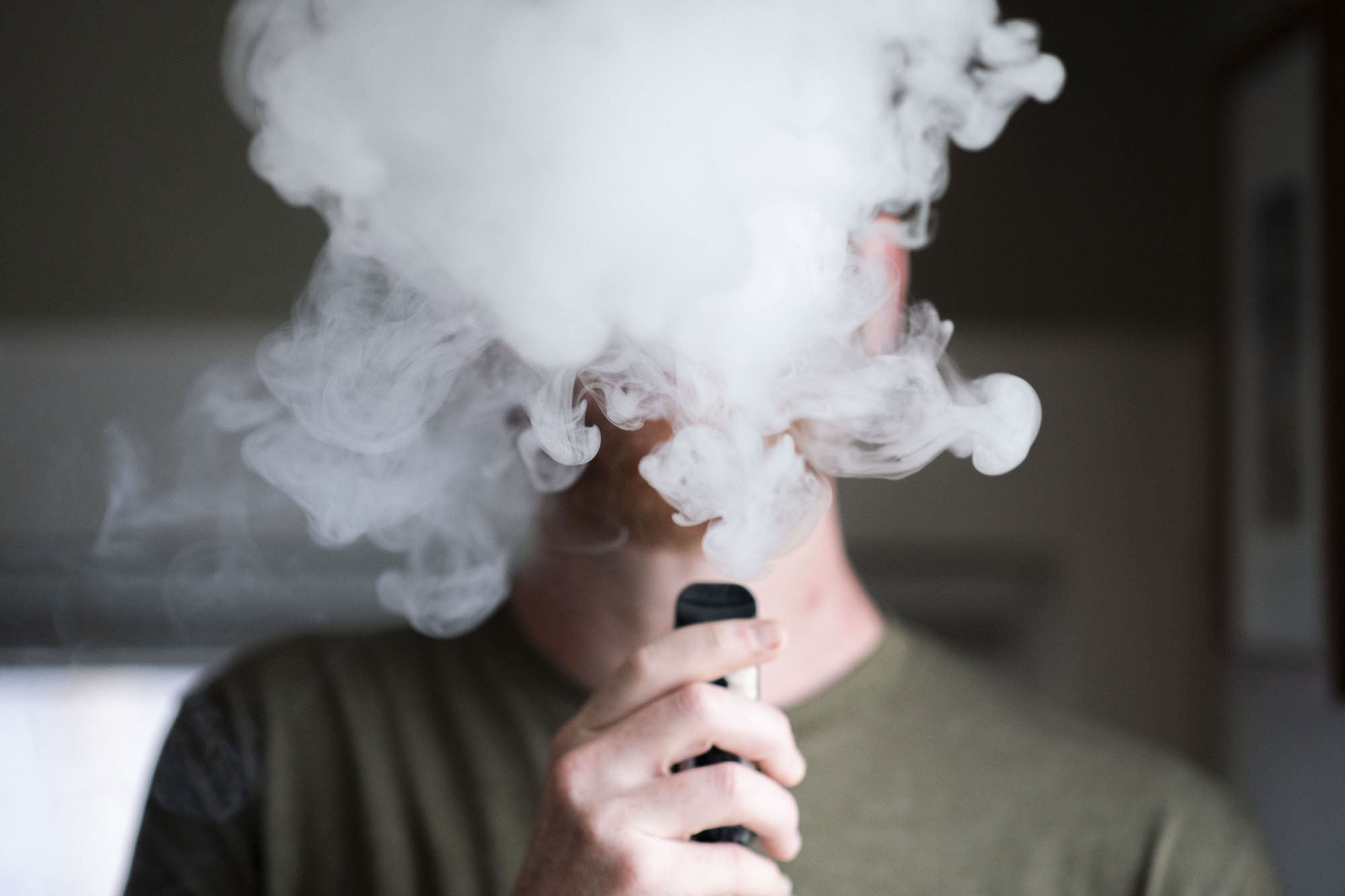 An e-cigarette vape plume is photographed in Denver in this Aug. 3, 2020 photo illustration.
