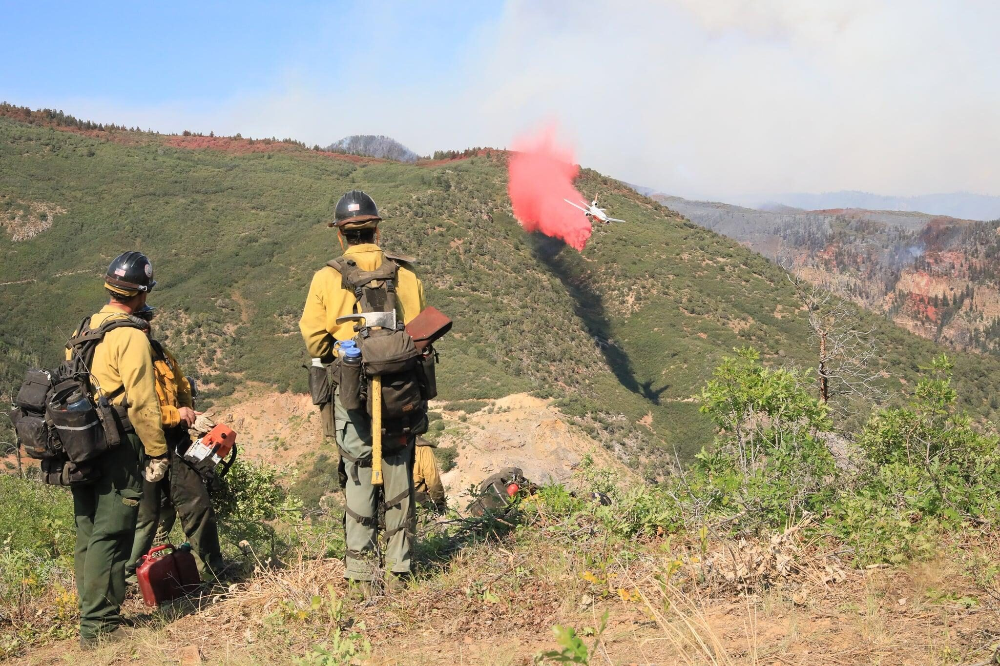 A plane drops retardant as part of efforts to fight the Grizzly Peak Fire near Glenwood Springs in August 2020.