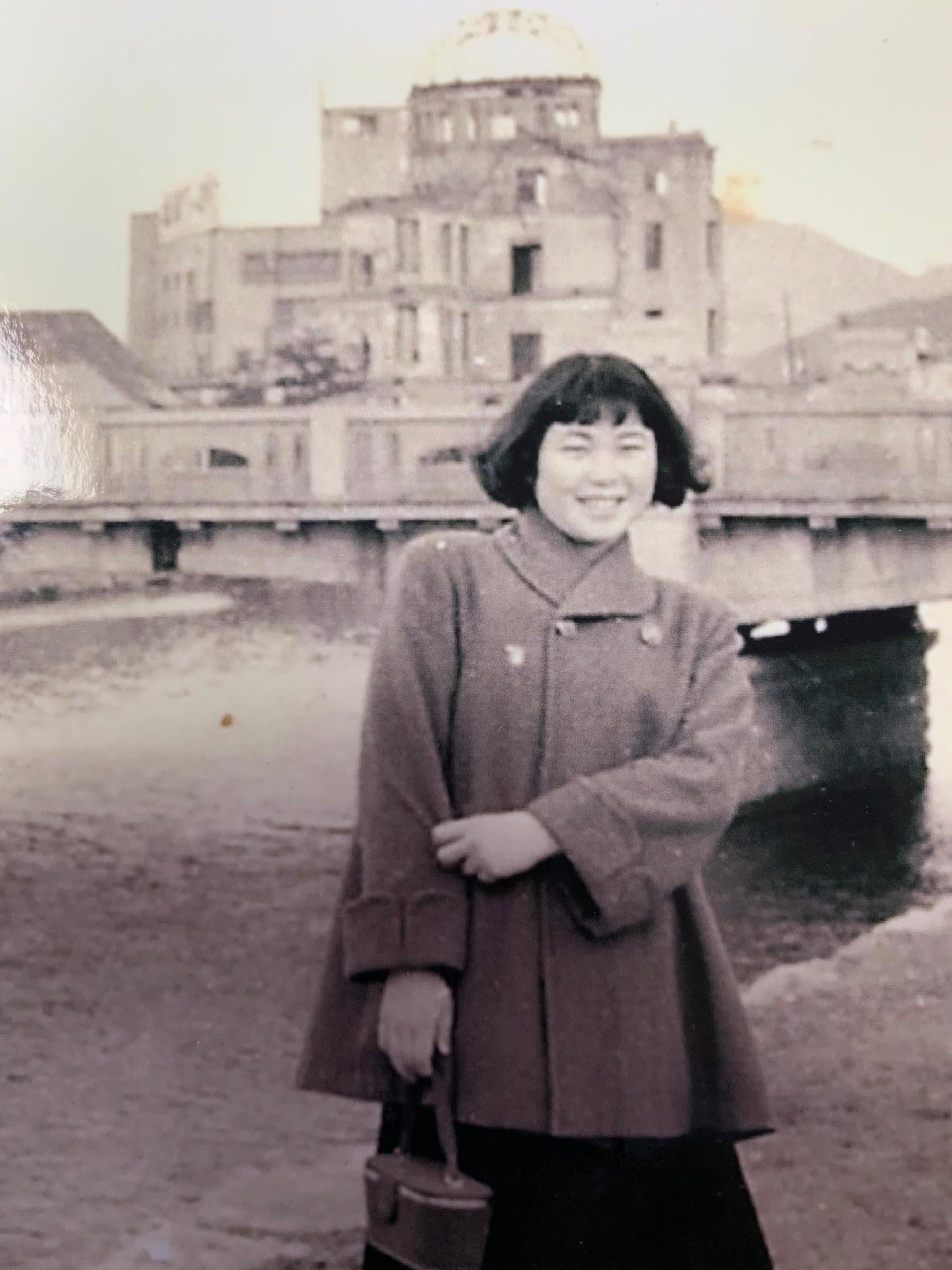 Sumiko Yoshida survived the bombing of Hiroshima 75 years ago. Here she is at age 16 in front of the Gembaku Dome at the Hiroshima Peace Memorial in 1952.