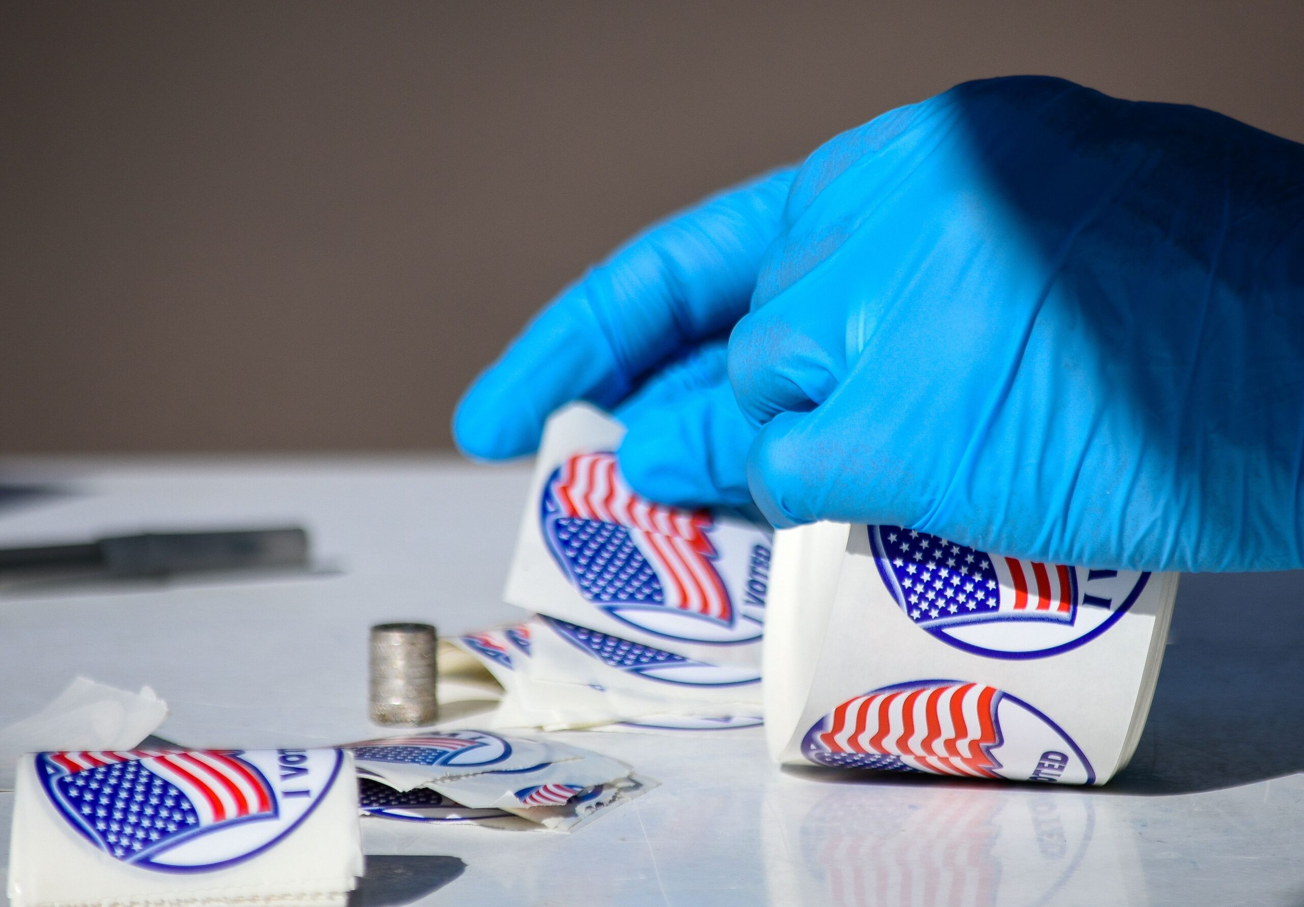 "A poll worker in Colorado Springs assembles ""I Voted"" stickers for voters."