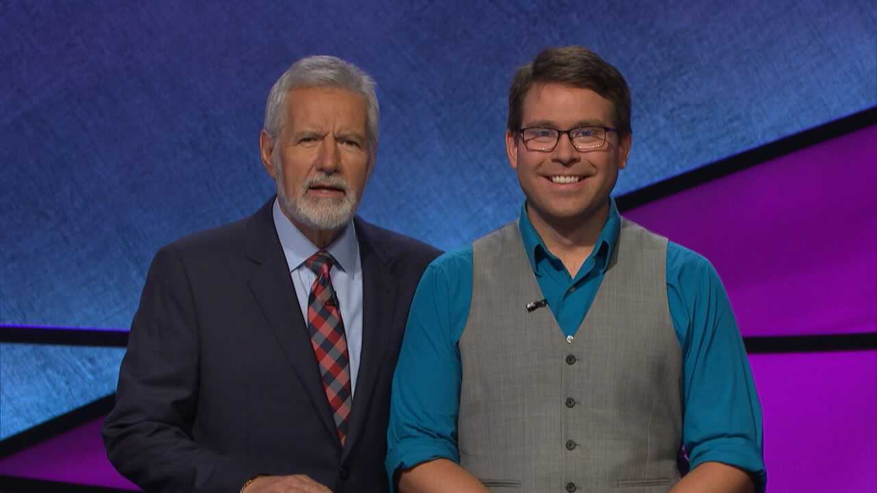 "Past ""Jeopardy"" winner and music teacher Kyle Jones, of Aurora, with Alex Trebek."