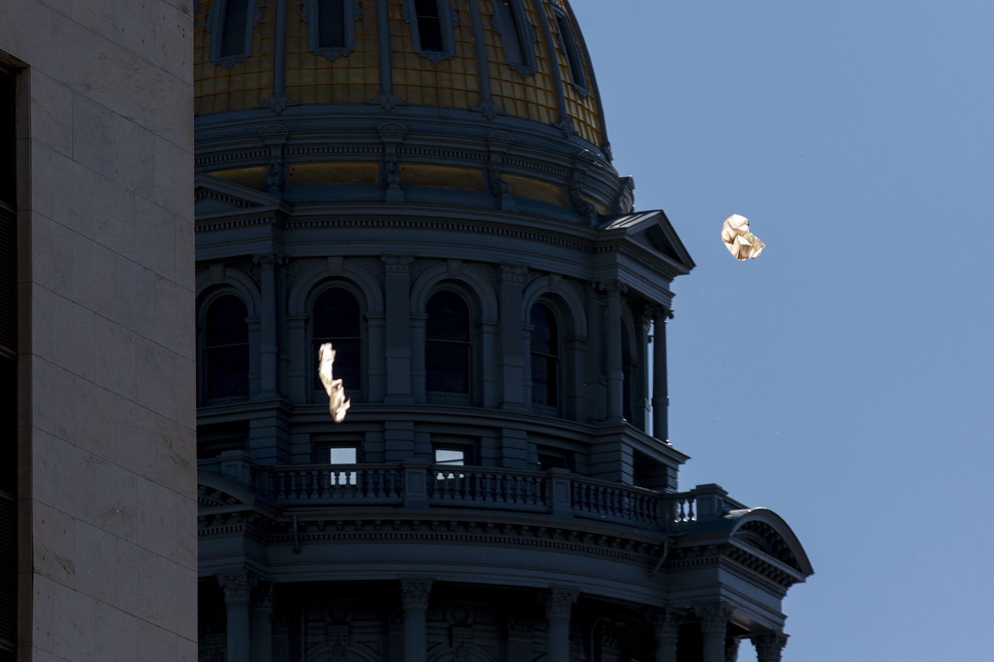Plastic bags float in the breeze on a very windy day outside of the Colorado State Capitol.