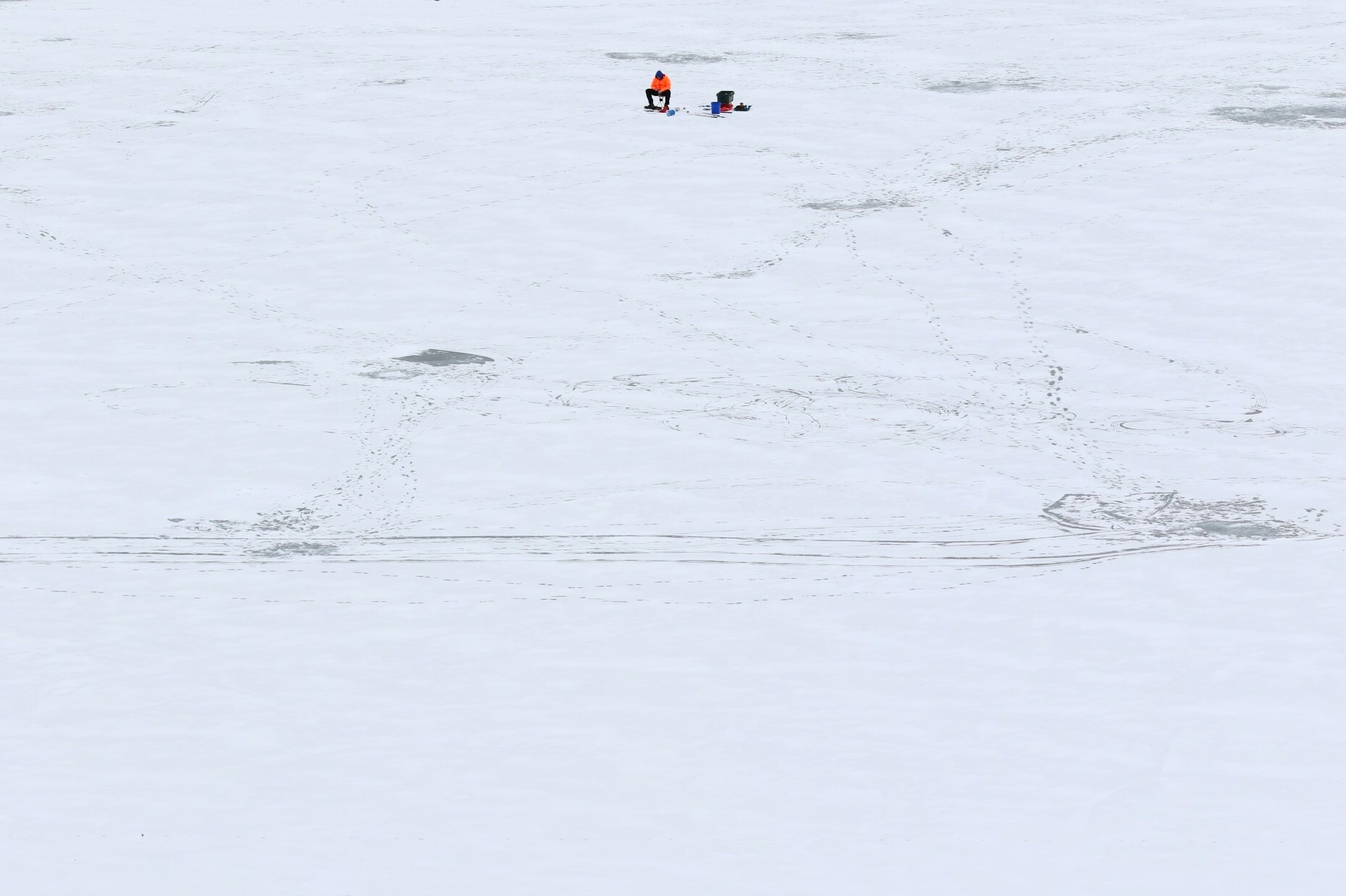 A man ice fishes on the Chatfield Reservoir in Littleton, Colorado on Feb. 16, 2021.