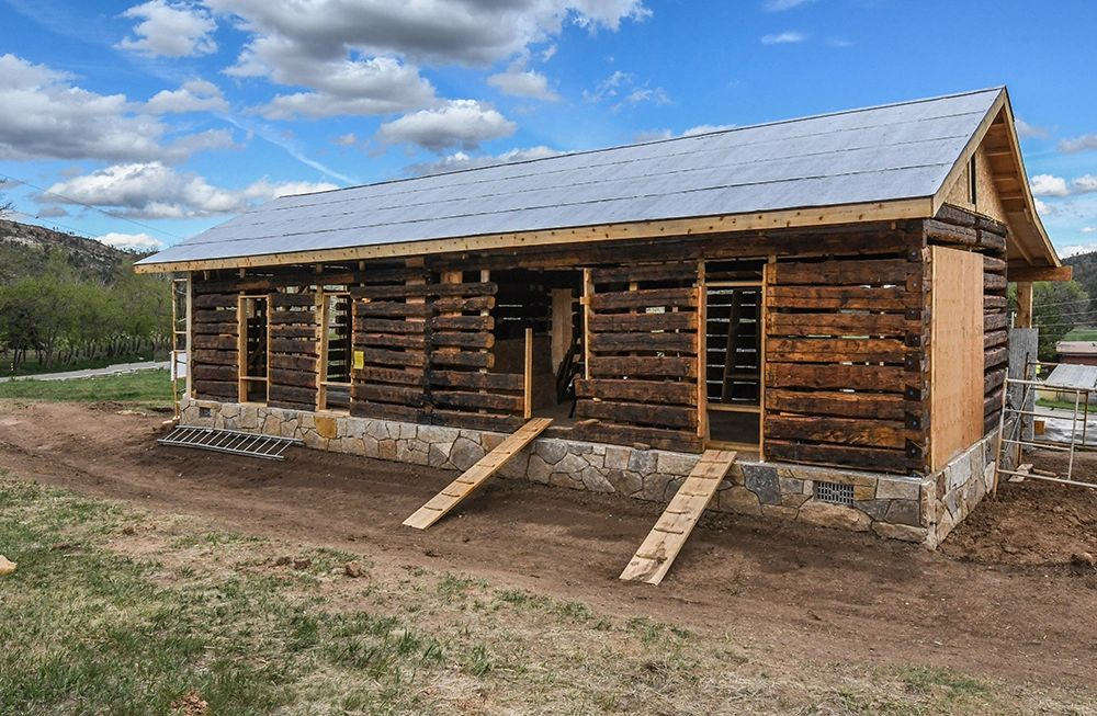 The Dotson cabin with a fresh coat of oil for preservation, and mid-roofing project in May 2020