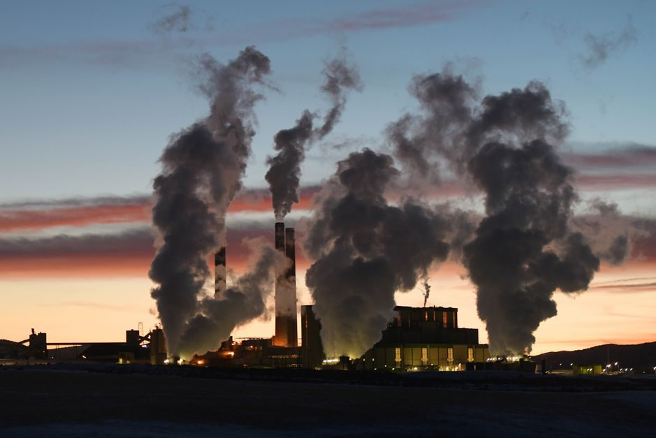 The sun sets as emissions rise from the Craig Station coal-burning power plant in Moffat County, Colorado. Coal is a major economic driver in the community, and the plant is scheduled to close by 2030.
