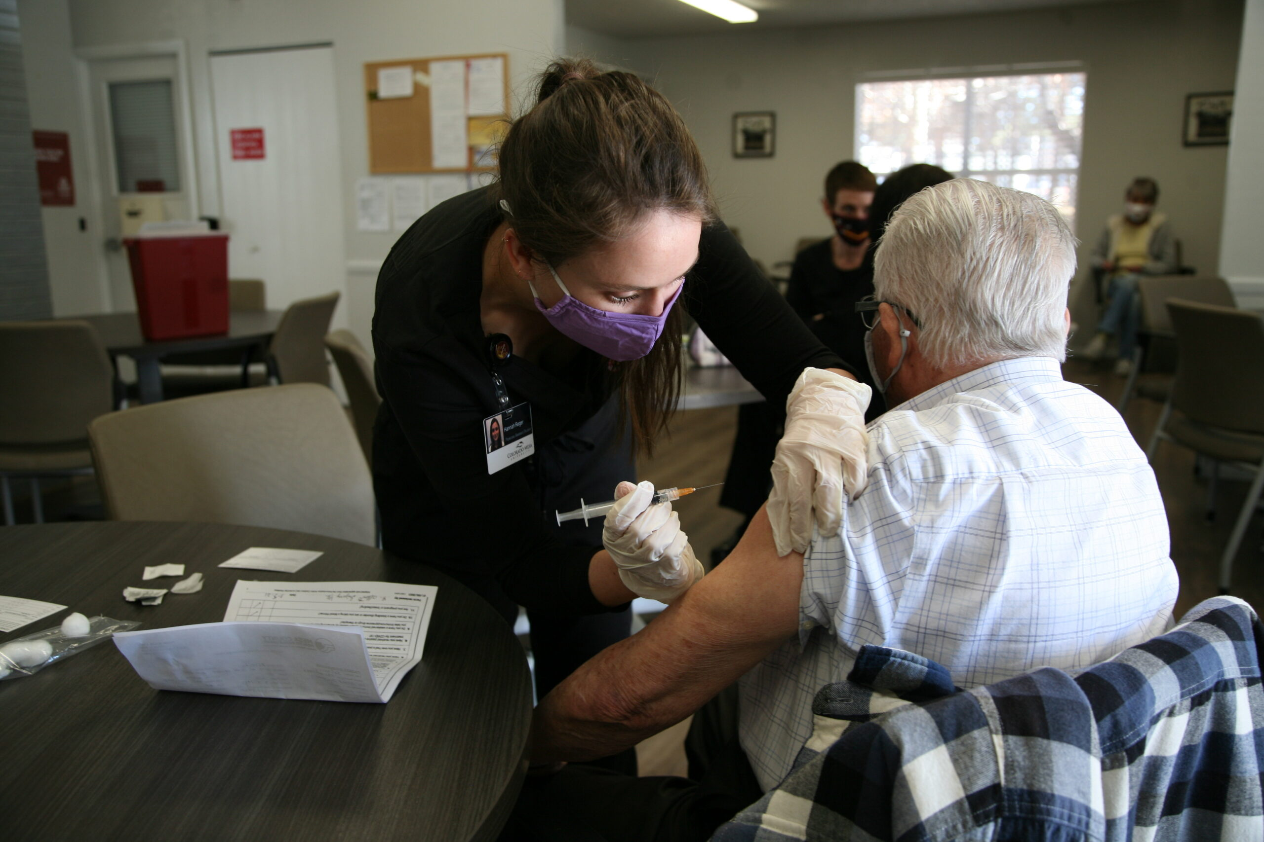 Alberto Irizarry receives the one-dose Johnson and Johnson vaccine from Hannah Reger, a physician assistant student at Colorado Mesa University. CMU and Mesa County Public Health recently brought the vaccine to 154 residents of independent living communities in the county.