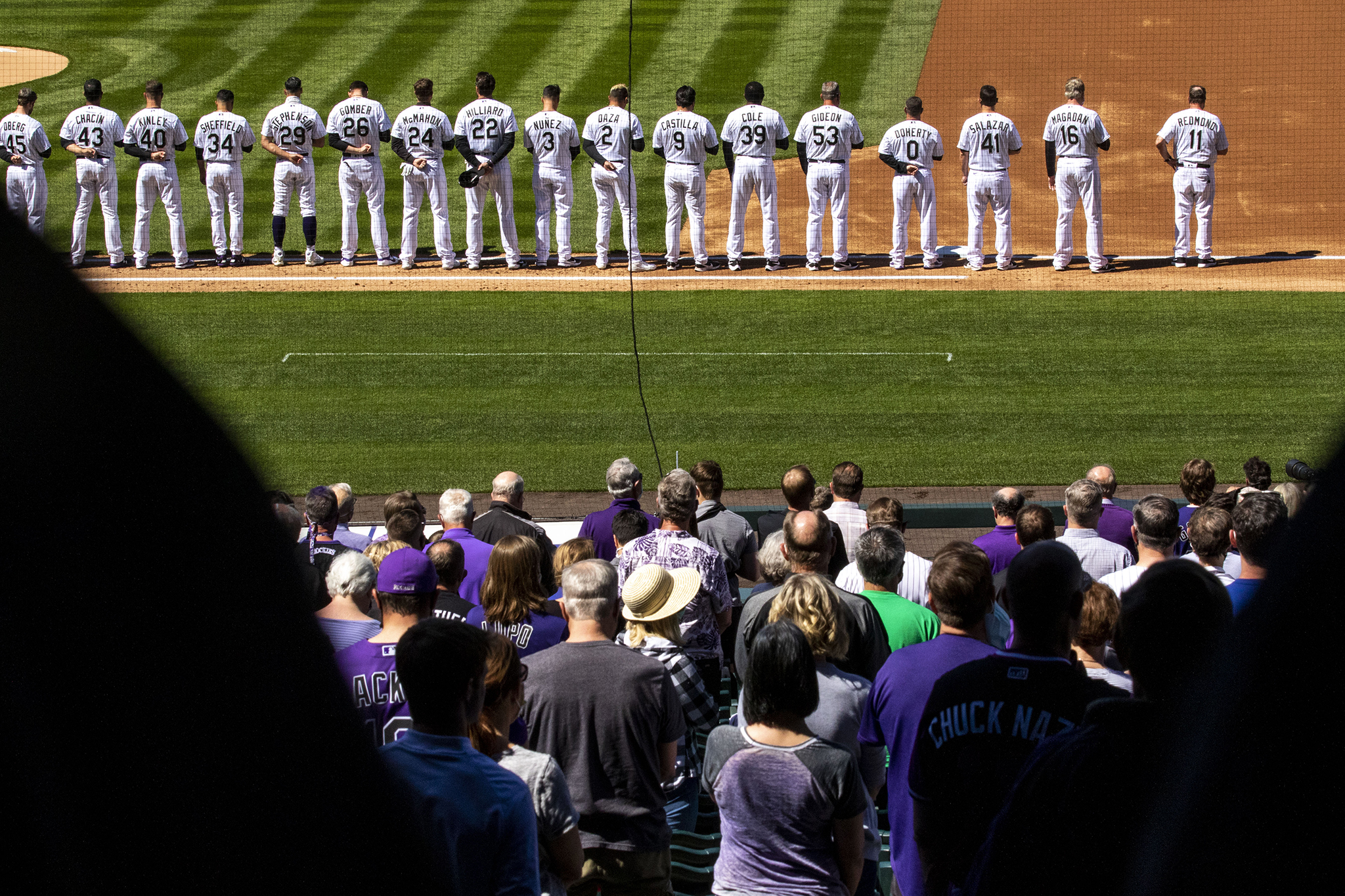 Everyone in Coors field pauses for a moment of silence for the ten people gunned down in a Boulder King Soopers before the Rockies face off against the Los Angeles Dodgers on opening day. April 1, 2021.