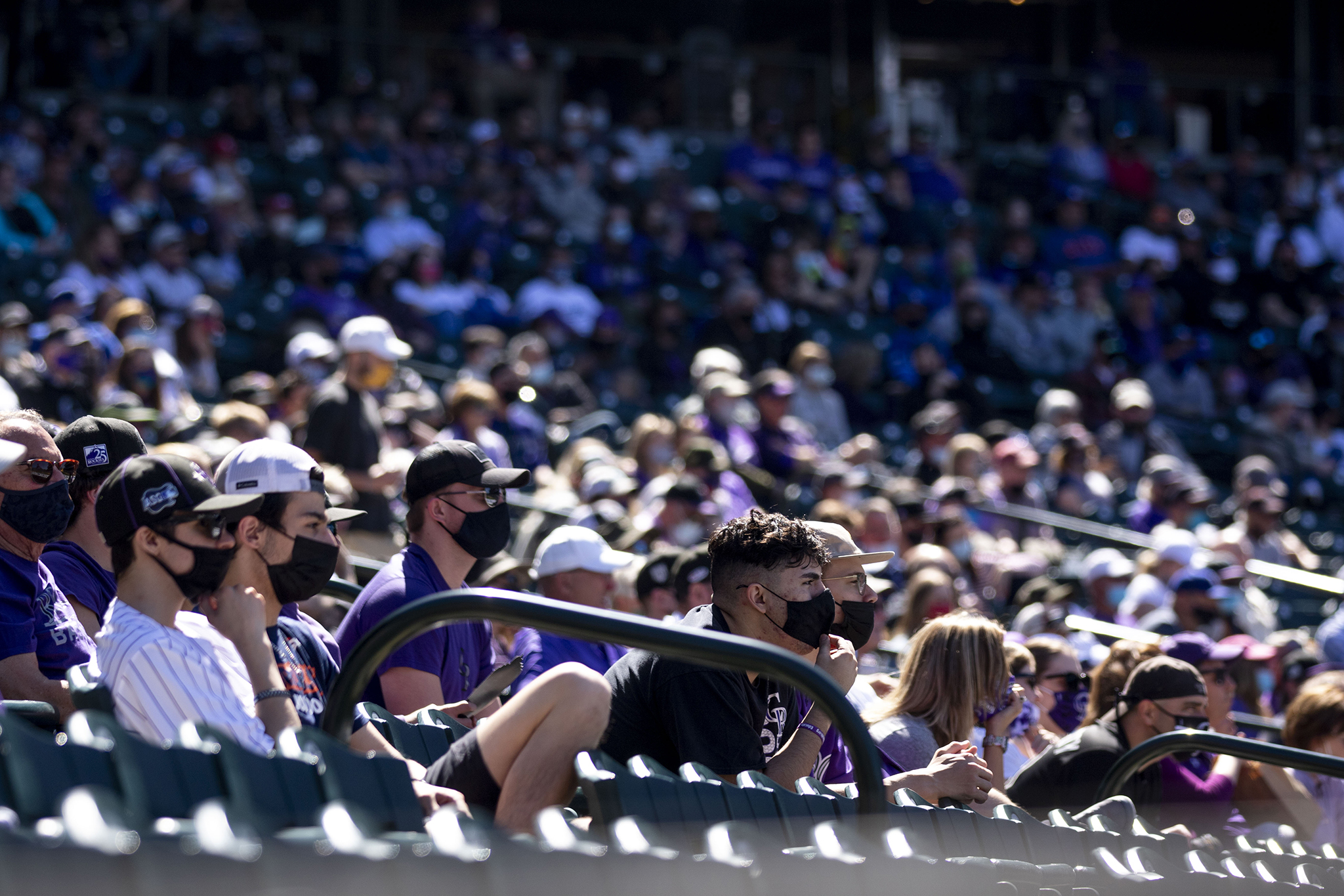 Masks proliferate the grandstands as the Rockies face off against the Los Angeles Dodgers on opening day at Coors Field. April 1, 2021.