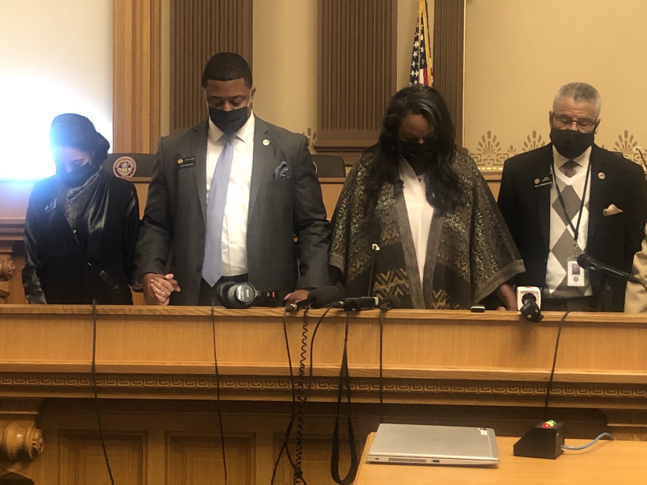 Members of Colorado's Democratic Black Caucus stand in prayer shortly after the Derek Chauvin verdict is announced, April 20, 2021. From left to right: Rep. Iman Jodeh, Sen. James Coleman, Rep. Leslie Herod, and Rep. Tony Exum Sr.