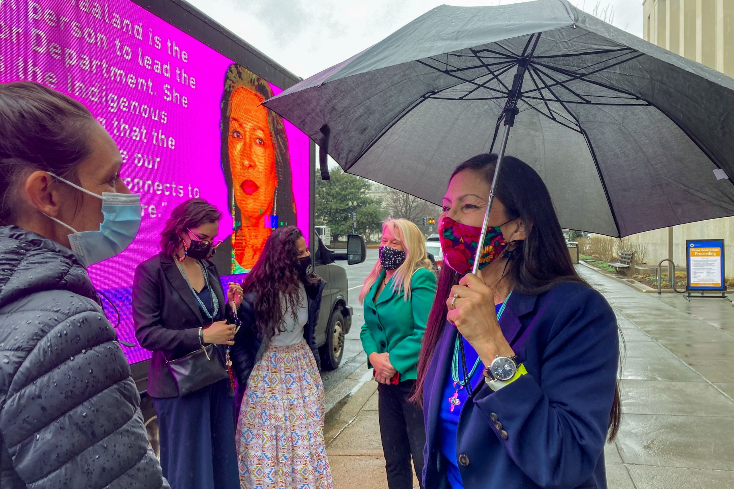 Sec. Deb Haaland talks with a small group of supporters, who waited in the rain, to welcome her on her second day as Secretary of the Interior, March 18, 2021.