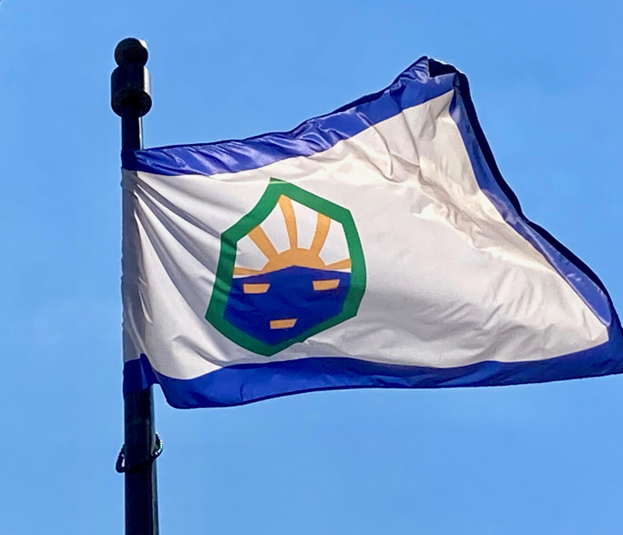 The Colorado Springs city flag flies outside the City Administration building in July 2021.