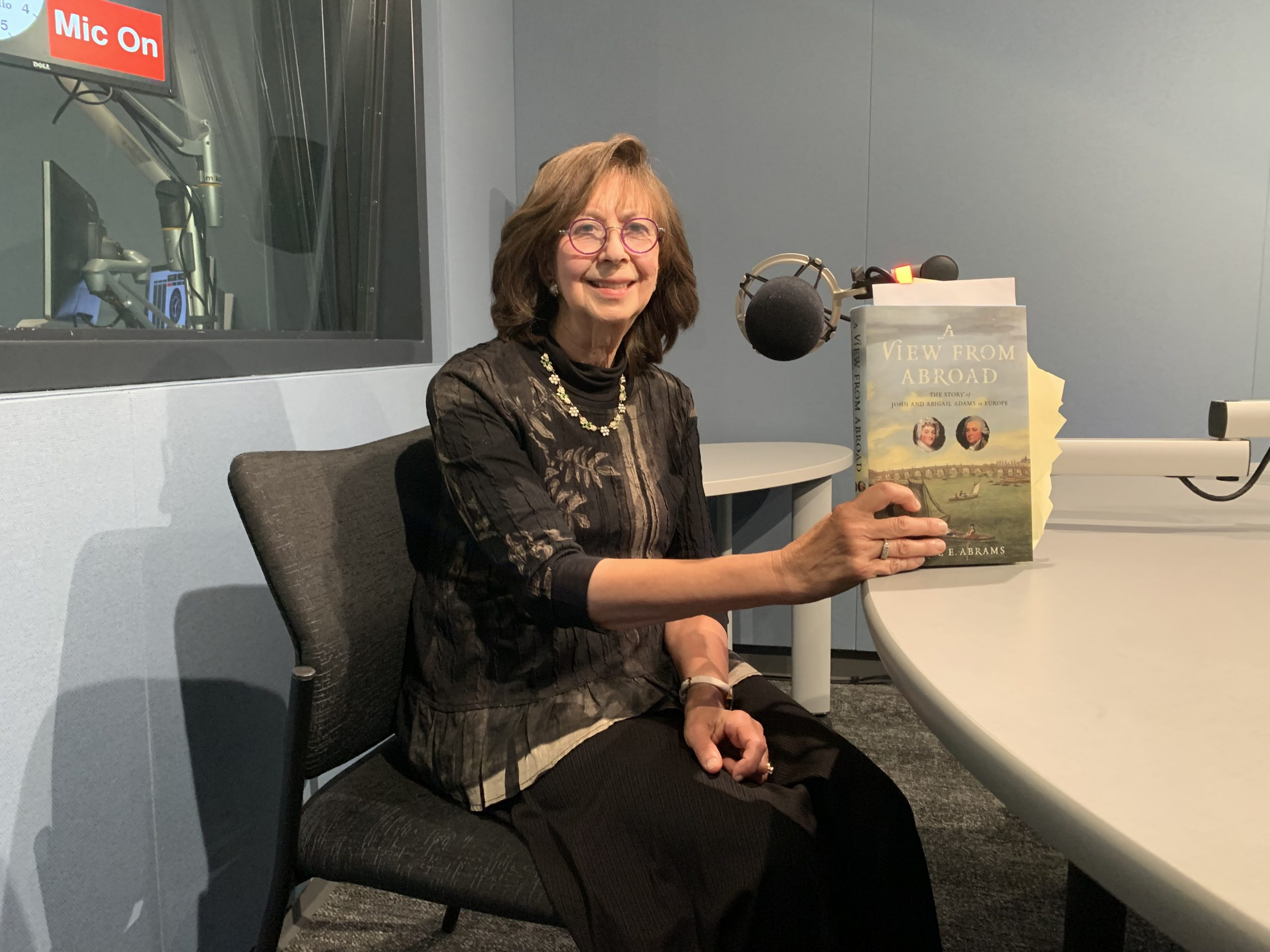 """Author Jeanne Abrams holds up her newest book, """"A View From Abroad: The Story of John and Abigail Adams in Europe."""""""