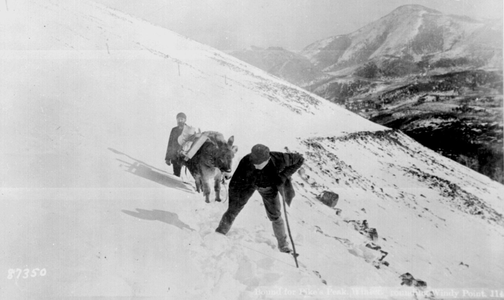 Climbing Pikes Peak, Colorado, in winter, rounding Windy Point, ca. 1890.