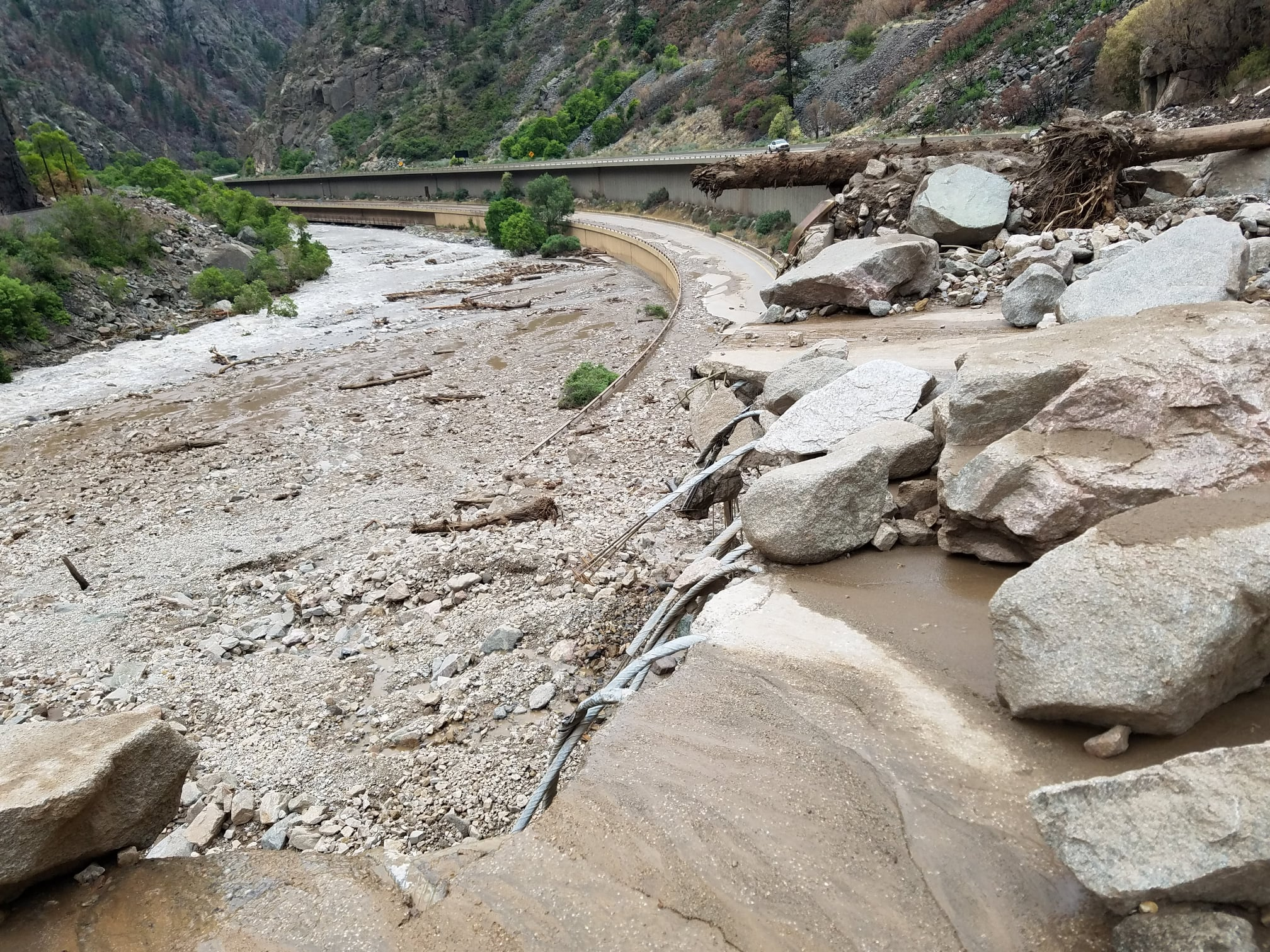 """On Aug. 1, transportation officials announced that Glenwood Canyon through I-70 has suffered """"extreme damage"""" from recent mudslides and will remain closed for days, if not weeks. On July 29, more than 100 people were trapped in one such mudslide, spurred by a torrential downpour that brought a deluge of rocks, logs and mud onto the highway."""