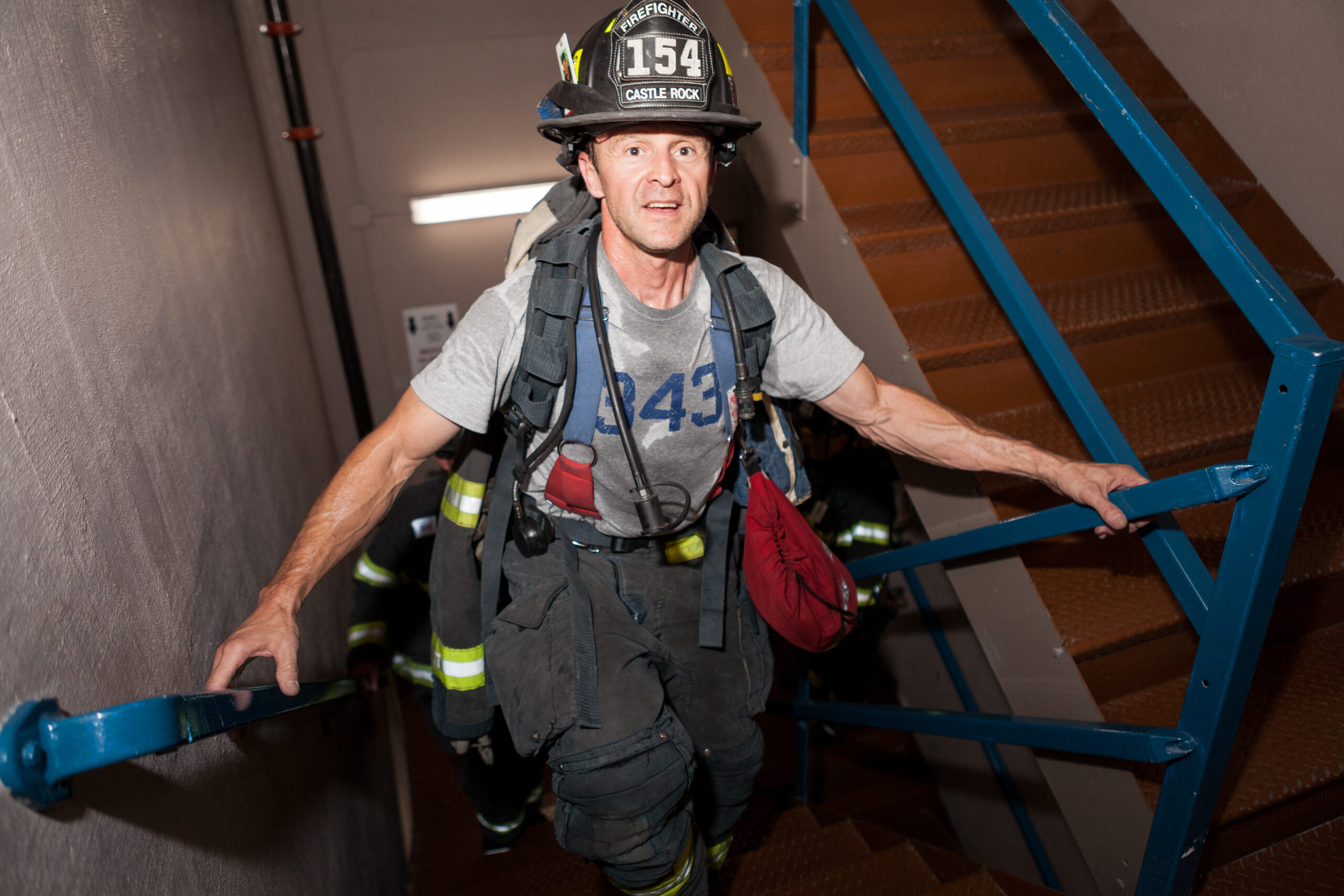 Geoff Polidoro, a firefighter with the Castle Rock Fire and Rescue Department, climbs the stairs during the 2016 annual 9/11 stair climb in downtown Denver.