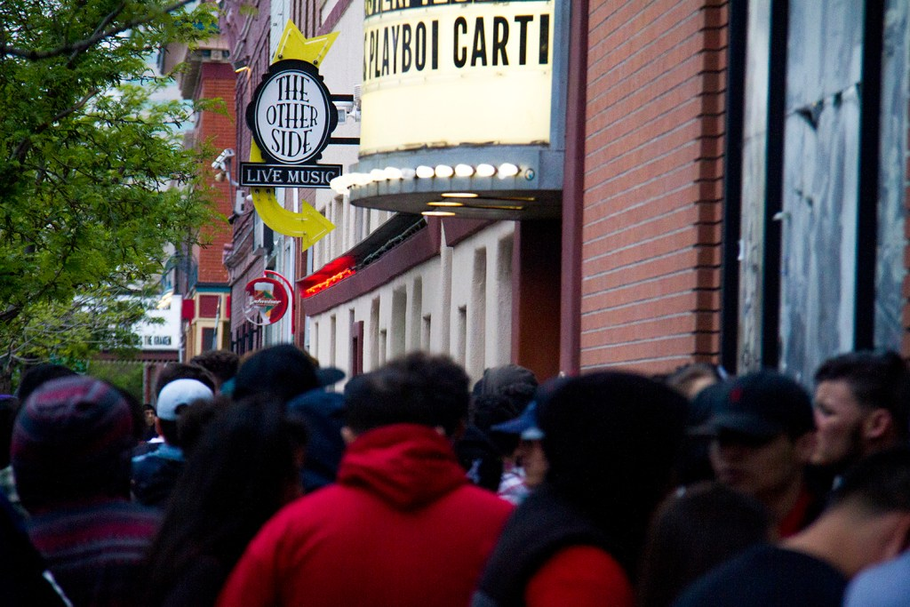 A long line of people wait to enter Cervantes' Masterpiece Ballroom. (Kevin J. Beaty/Denverite)  cervantes; five points; venue; concert; light rail; train; transportation; bars; food; dining; drinks; denver; denverite; colorado; kevinjbeaty