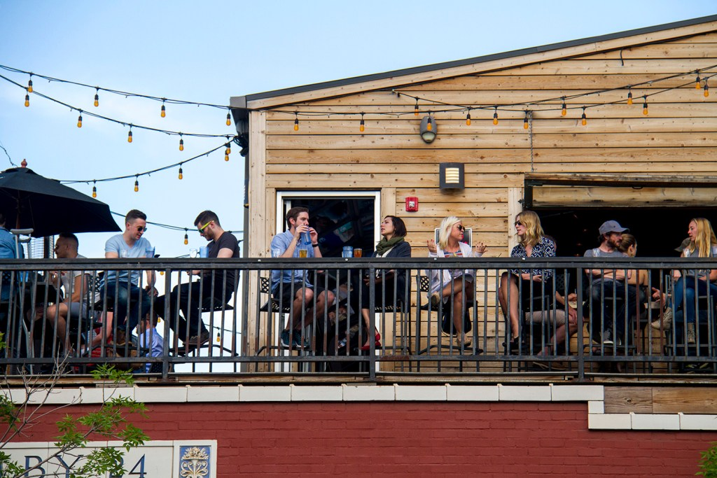 Patrons enjoy Historians' rooftop patio. (Kevin J. Beaty/Denverite)  speer; south broadway; patio; dining; food; entertainment; bars; restaurants; denver; denverite; colorado; kevinjbeaty