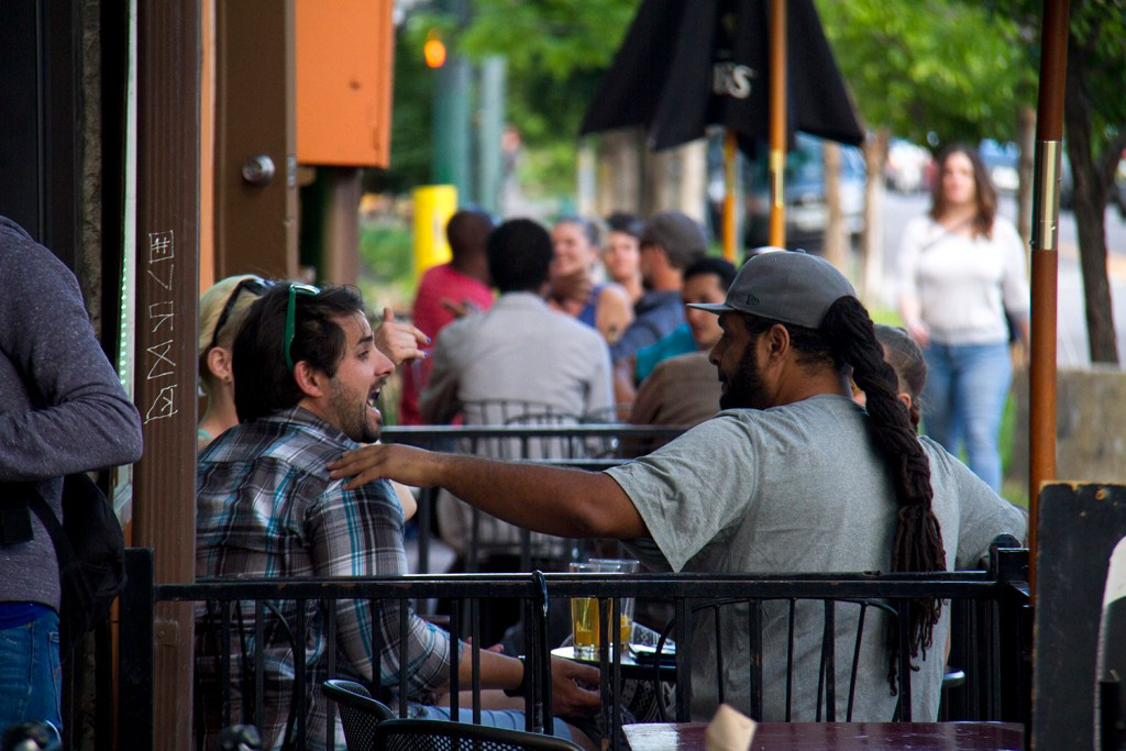 Patrons enjoy the patio at Dougherty's Restaurant & Pub. (Kevin J. Beaty/Denverite)