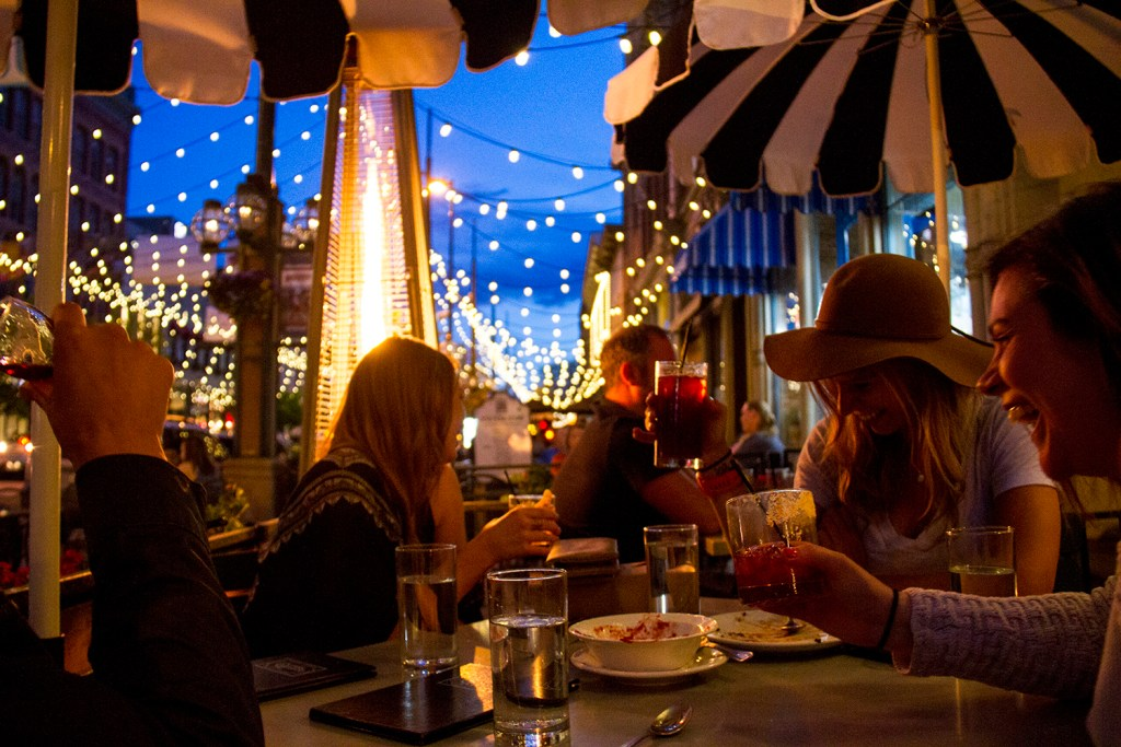 Dining on Tag's patio after dark under Larimer Square's iconic light strings. (Kevin J. Beaty/Denverite)