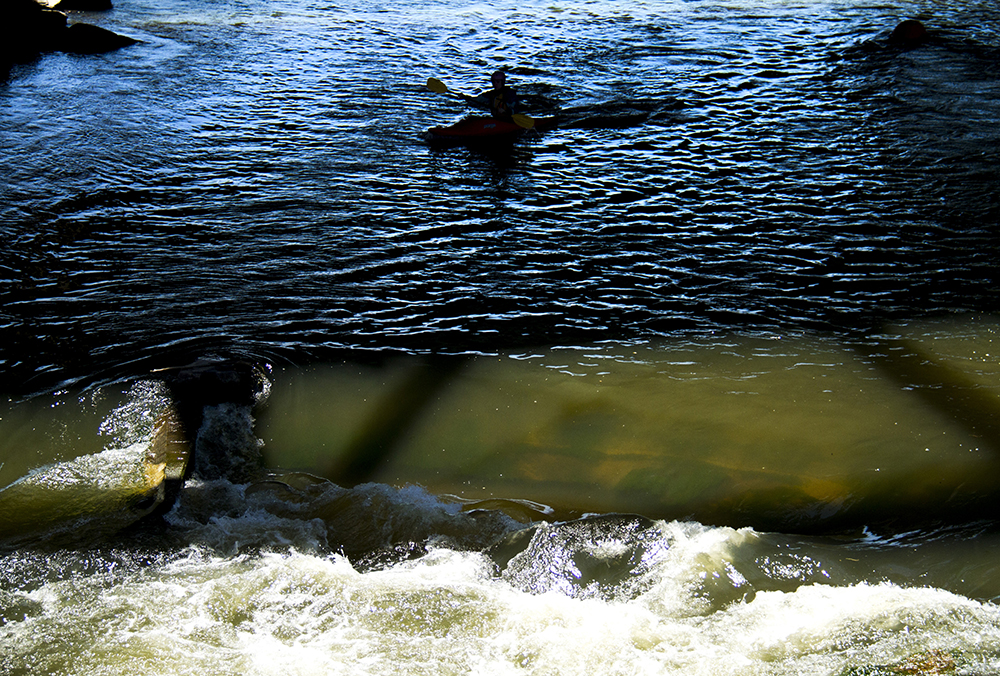 Alex Tyk, an experienced kayaker, cruises South Platte River rapids at Confluence Park. (Kevin J. Beaty/Denverite)  confluence park; platte river; kayak; sports; recreation; denver; denverite; colorado; kevinjbeaty